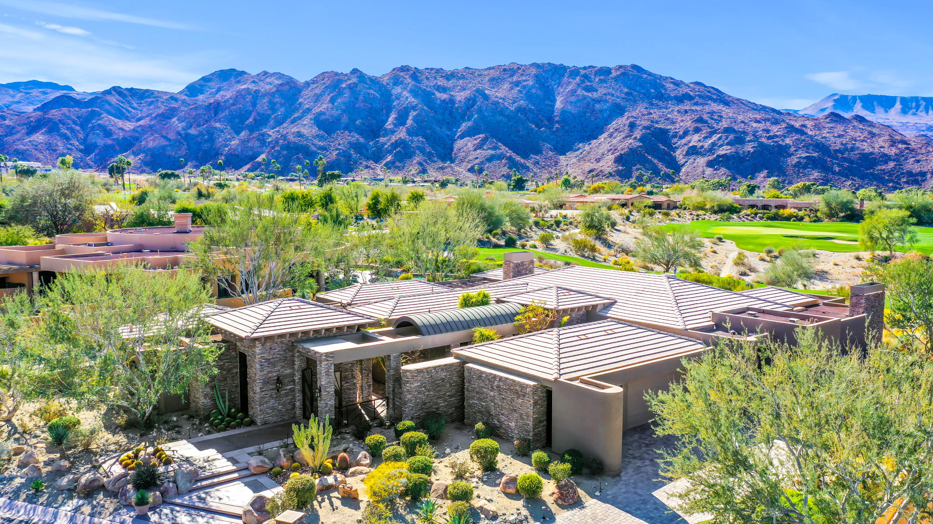 Look no further! This home is the true trifecta! Timeless architectural lines, awe inspiring views, serene and tranquil location. This desert contemporary home designed by renown local firm of Holden & Johnson checks off all the boxes. A modern arched entry greets visitors amid dramatic stacked stone details. Once within the home, one is immediately drawn to the expansive walls of glass revealing a 180 degree sweeping lookout, exposing elevated perspectives from snow capped peaks to the down valley views of the Whitewater windmills. Three bedrooms in the main home will assure there's plenty of space for family gatherings, while special guests will enjoy the privacy of the detached casita, complete with a complimenting sitting room in addition to the homes 4th bedroom and ensuite bath. Despite all of the home's modern comforts, it's tour de force is the rear spacious pool side loggia - complete with outdoor dining, telescoping shade awnings, plenty of leisure lounging space, climate controlling overhead gas heat and a conveniently positioned built-in BBQ off the kitchen.