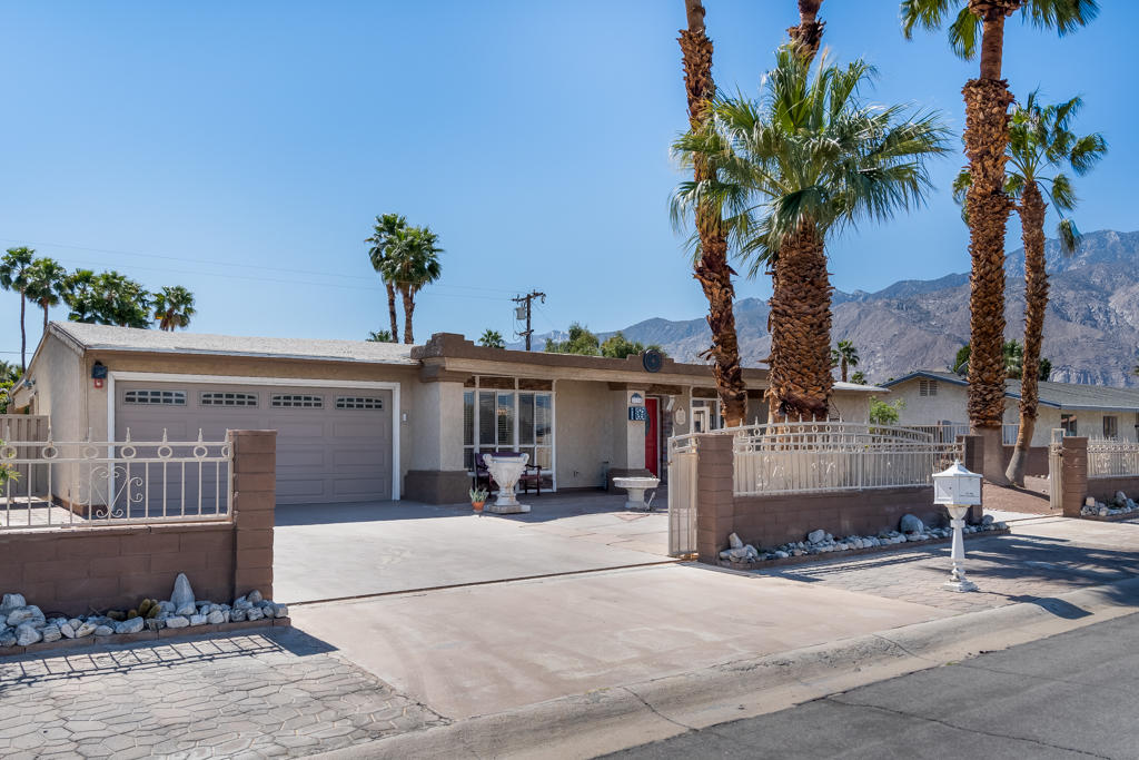 Amazing opportunity in Palm Springs - you own the land (no land lease)! This 4 bedroom, 2 bath property is ready for your personal touch. All the 'bones' are there. The galley kitchen features stainless steel appliances and granite counters and opens to the large dining space and living area. There is a large addition which is perfect for a number of different uses - game room, office, she-shed, man-cave -- let your creativity run wild! The backyard is large, offering mountain views and there is plenty of room for a pool if that is your desire. The location can't be beat - close to the airport and all Palm Springs has to offer.