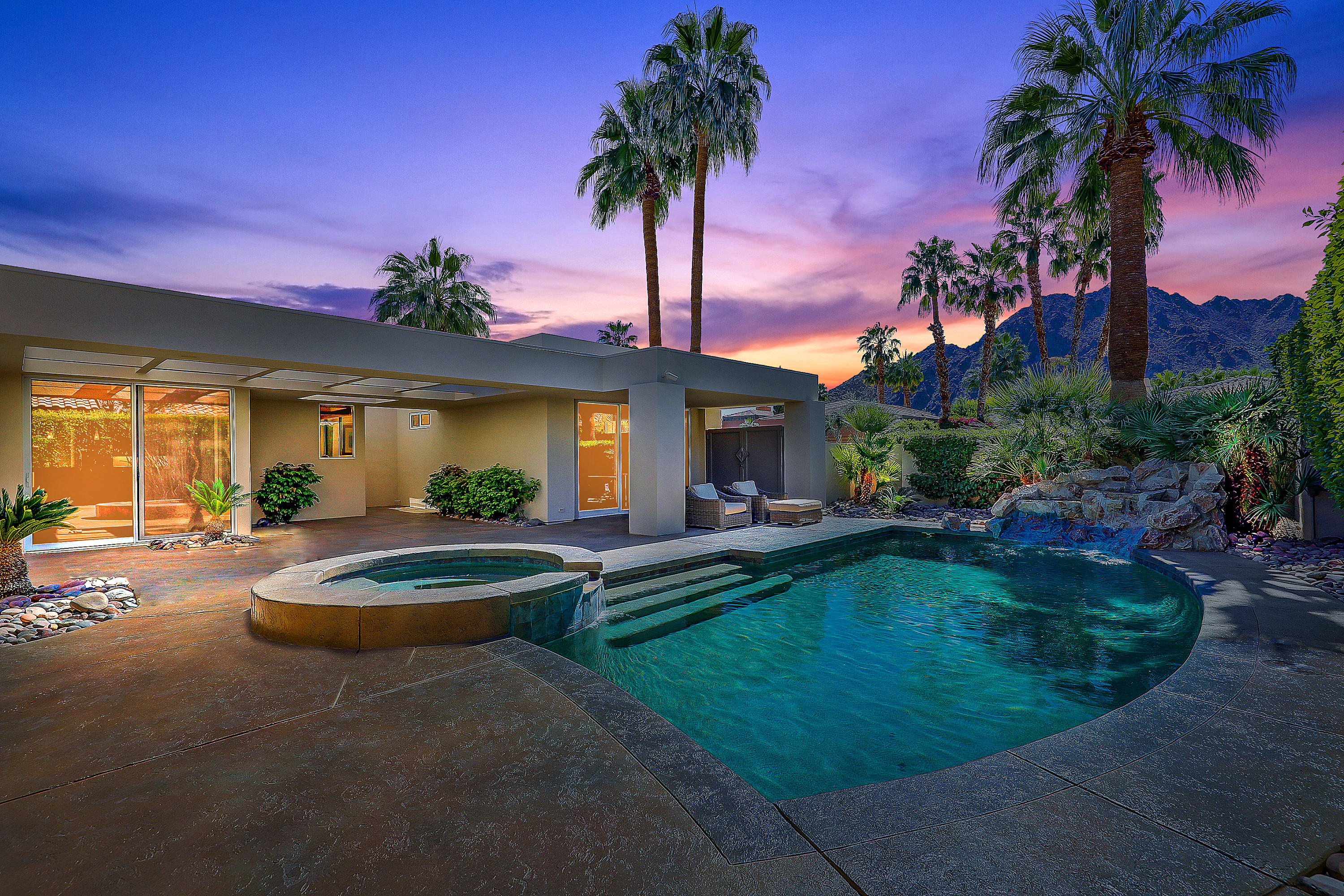 Beautiful Modern, Contemporary semi-Custom Ministrelli home located within prestigious Painted Cove community at Indian Wells Country Club.  Outstanding south facing mountain views, large private Courtyard with pebble tech pool, spa, and waterfall! Beautiful back lawn and patio. Open Floor plan offers 3770 Sq. Ft., 4 bed, 4.5 bath, 2 cars + golf cart garage, includes spacious Guest Casita and picturesque views. Travertine floors throughout with rich wood plank porcelain floors in Living Room, Master Bedroom, and Casita. Glass French doors open into Living Room with cathedral ceilings, modern fireplace, and formal Dining area with gorgeous chandelier. Newly remodeled Gourmet Kitchen has white quartz countertops, kitchen island with storage, two stainless sinks, bar seating, informal dining area and cozy patio.  Family Room adjoins with built in media center. Separate Master Bedroom Suite with outstanding south views and glass sliders access to lush pool/spa and patio.  Spacious Master Bath has new stand-alone tub, his/her vanities and walk-in closets.  Guest Bedrooms are carpeted with en-suite Baths and private patios. Private entry Guest Casita has full bath, walk-in closet, custom built-ins, perfect for home office. Large Laundry Room with lots of cabinetry, deep tub sink, stainless washer/dryer.