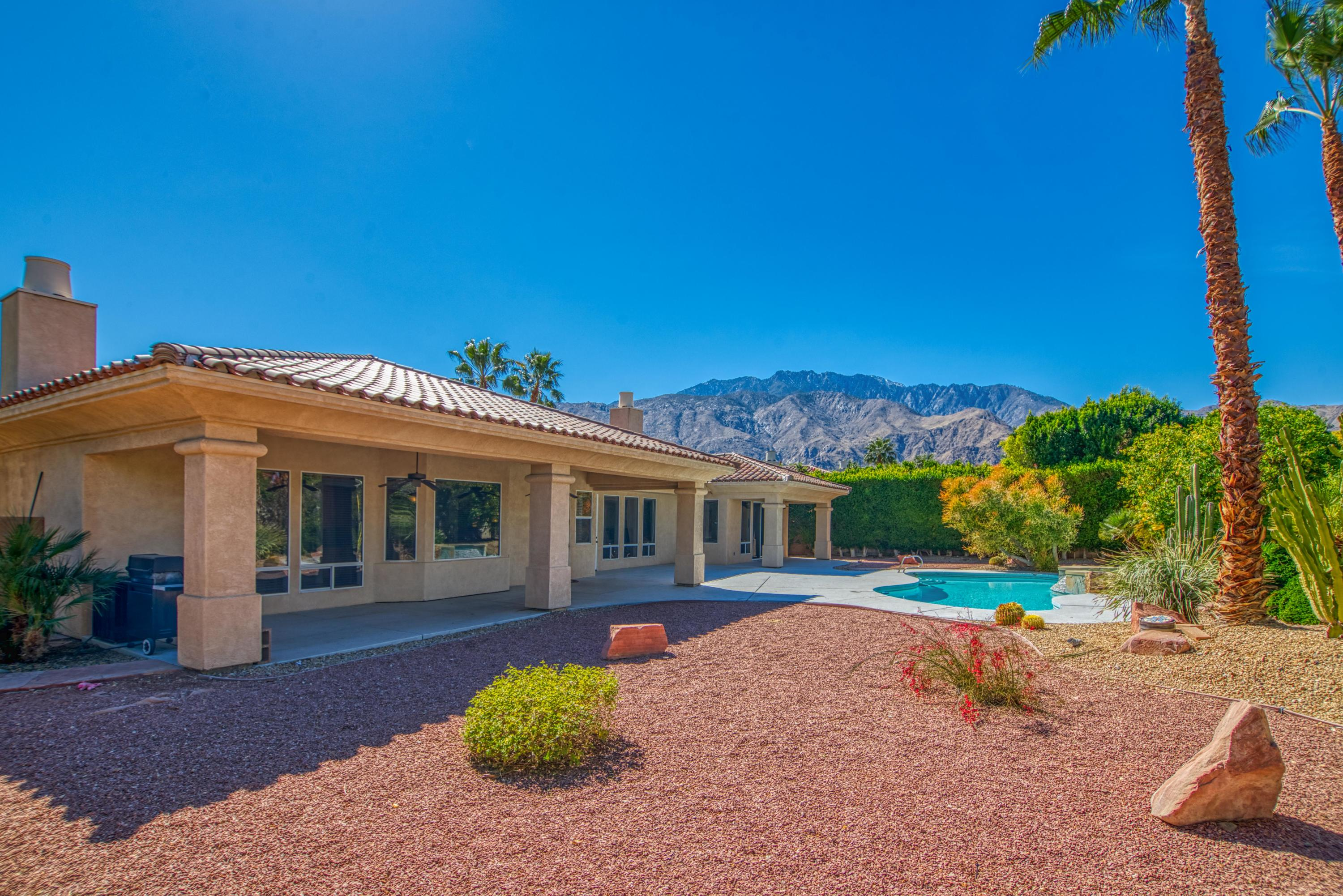 High ceilings, multiple entertaining areas, modern enhancements including porcelain tile throughout and a private backyard with pool, spa and mountain views all located within one mile of downtown Palm Springs.  This 4 bed, 3.5 bath home at Colony El Mirador is ready for you to enjoy!  Formal entry opens to the south-facing formal dining room as well as the adjacent living room that has a vaulted ceiling, gas fireplace, and access to the backyard.  Adjacent powder bath, too!  Separate great room includes a light and bright kitchen styled up with quartz counters, stainless appliances and a large detached island that opens to the casual dining area as well as a large family room with gas fireplace, entertainment center and custom cabinets.  Easy access to the backyard!    You will also love the large laundry room with sink that leads to the three car garage that includes storage.  Master Suite opens to the backyard and has a private bath with dual sinks, a walk-in shower, separate tub and a large walk-in closet.  South-facing Junior Ensuite Two connects to a hallway bath also services Bedroom Three.  On the other side of the house is Bedroom Four which connects to a private bath.