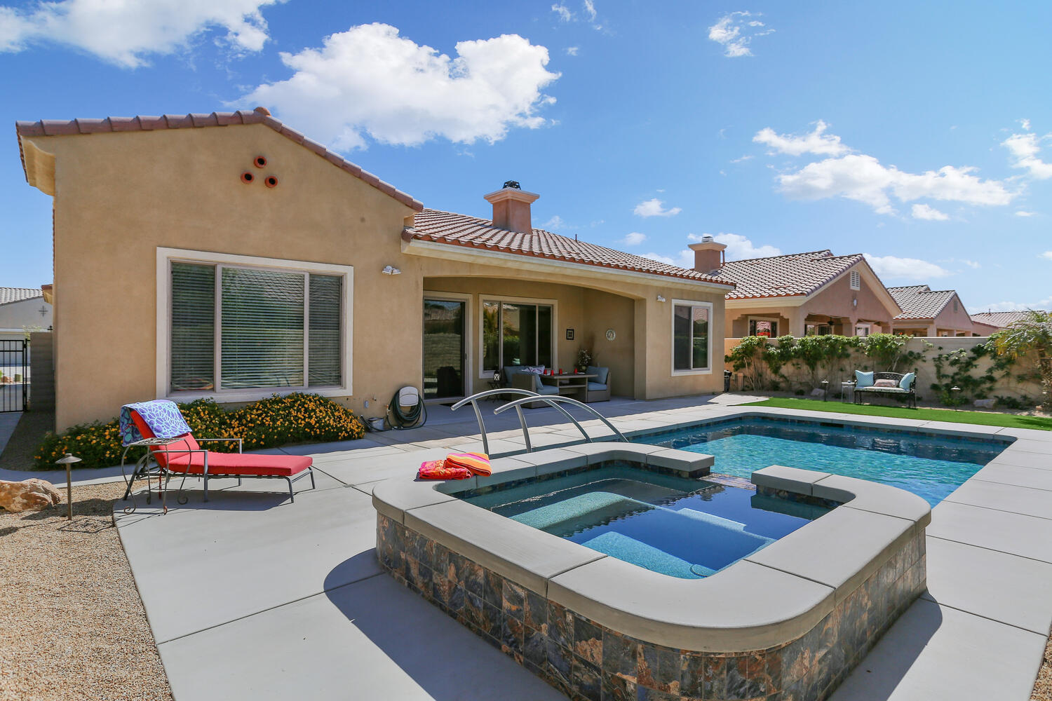 Quintessential West-facing Castellano (2230 sq.ft) on private lot with filtered mountain views. Enter through iron gated courtyard to an intricate patterned glass front entry door, opens to reveal a wide open Great room floor-plan. Brand-new Designer finished salt-water walk-swim pool & spa 4.5 ft deep, by 25 ft long, by Tesera pools with with warranty. Tinted windows in Living, Patio & Guest Bedroom for cooler interior. LED lighting in kitchen & outside patio. Oversized 2 car garage + golf cart garage w/ custom cabinets & shelving. Fully self enclosed den or media room with beautiful glass french doors. Inviting front office w/ built-in bookshelves opens to expansive front window overlooking courtyard. Small wood rounds on entire baseboards & Crown Molding around kitchen, living room & entry areas. Ceiling fans installed in every room. Deluxe built-in cabinetry by fireplace. All closets & pantry storage spaces contain extra shelving, including a re-built master closet. But wait, there's more: All new kitchen  with 2-tone cabinets & quartz counter-tops, new garbage disposal, dishwasher, and microwave. Also all new bathroom cabinets, with LED lighting & wall paper covering. Newer Evaporative cooler in garage. And negotiable (newer) washer & dryer. Move-in ready, meticulously maintained, and upgraded by original owner.