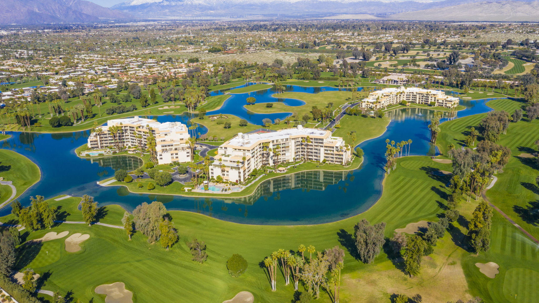 Very rare 3-bedroom end unit. You'll enjoy serene lake front views from floor-to-ceiling windows from every room in this spacious home.   Desert Island is a unique high-rise condominium community nestled on a lush green 25-acre island, surrounded by a sparkling lake and immaculate private 18-hole championship golf course. Most units average 2,000 square feet in size and offer spacious covered terraces with extraordinary views of the mountains, lake and golf course. Homeowners enjoy the beauty of the open grounds with walking paths, benches, fruit trees, tennis courts, heated swimming pools and spas, pedal boats, fishing and 24-hour guard gated entry.