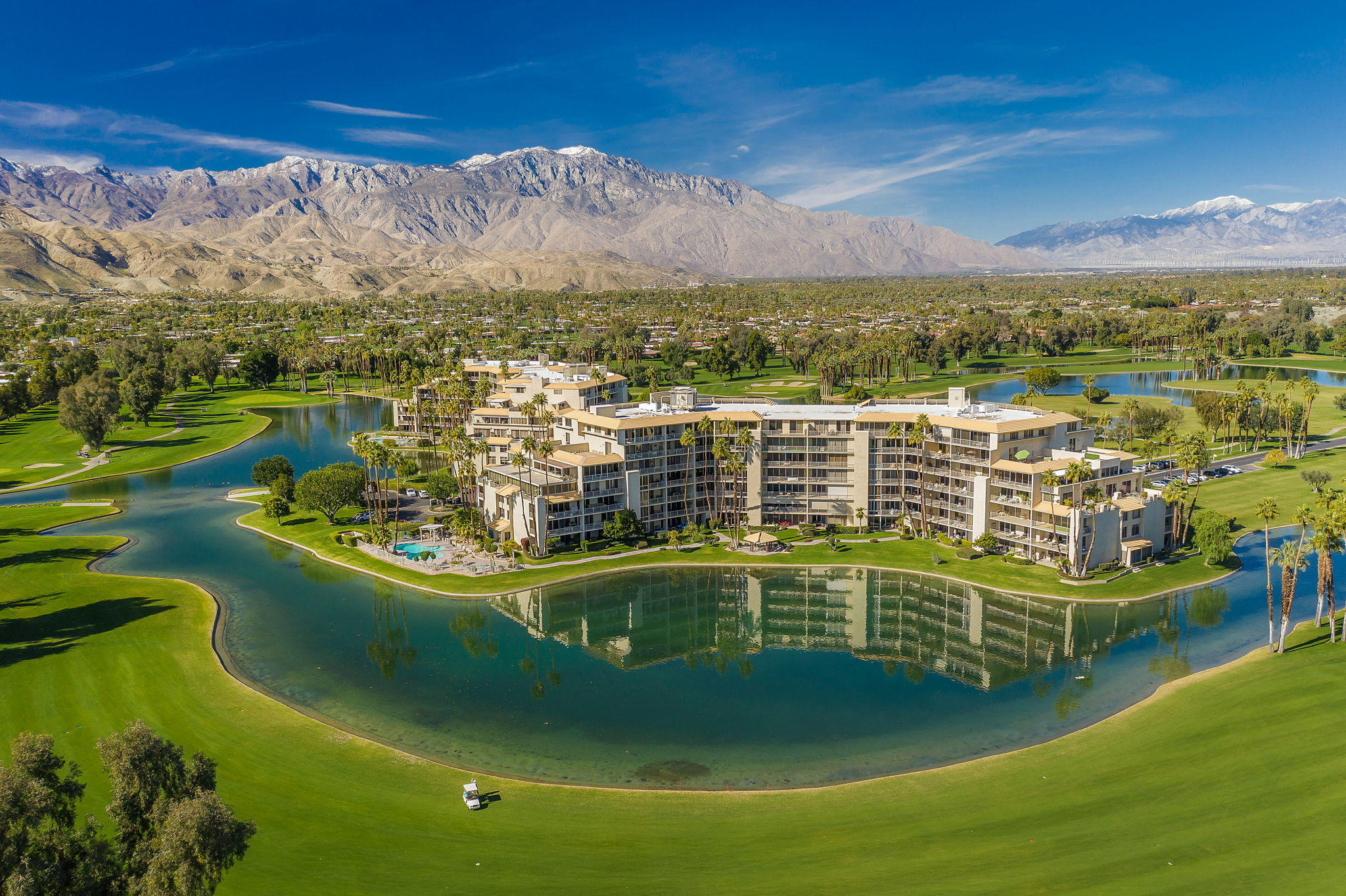 This spacious condo offers Spectacular Mountain, Lake & Golf Course Views through 9-ft walls of glass. You will enjoy this popular open floor plan perfect for entertaining, all rooms have direct access to huge terrace with gas BBQ jet, Master suite is spacious and has walk-in closet.  Most utilities are included, along with Air Conditioning, Cable TV & Internet.  This is an opportunity to buy a desirable location and floorplan perfect for remodel and make it your own.    Desert Island is a unique high-rise condominium community nestled on a lush green 25-acre island, surrounded by a sparkling lake and immaculate private 18-hole championship golf course.  Centrally located in Rancho Mirage, close to shopping, restaurants, casinos and much more. Homeowners enjoy the open park like grounds with walking paths, fruit trees, benches, tennis & pickle ball courts, heated swimming pools & spas, pedal boats, fishing and 24hour guard gated entry.