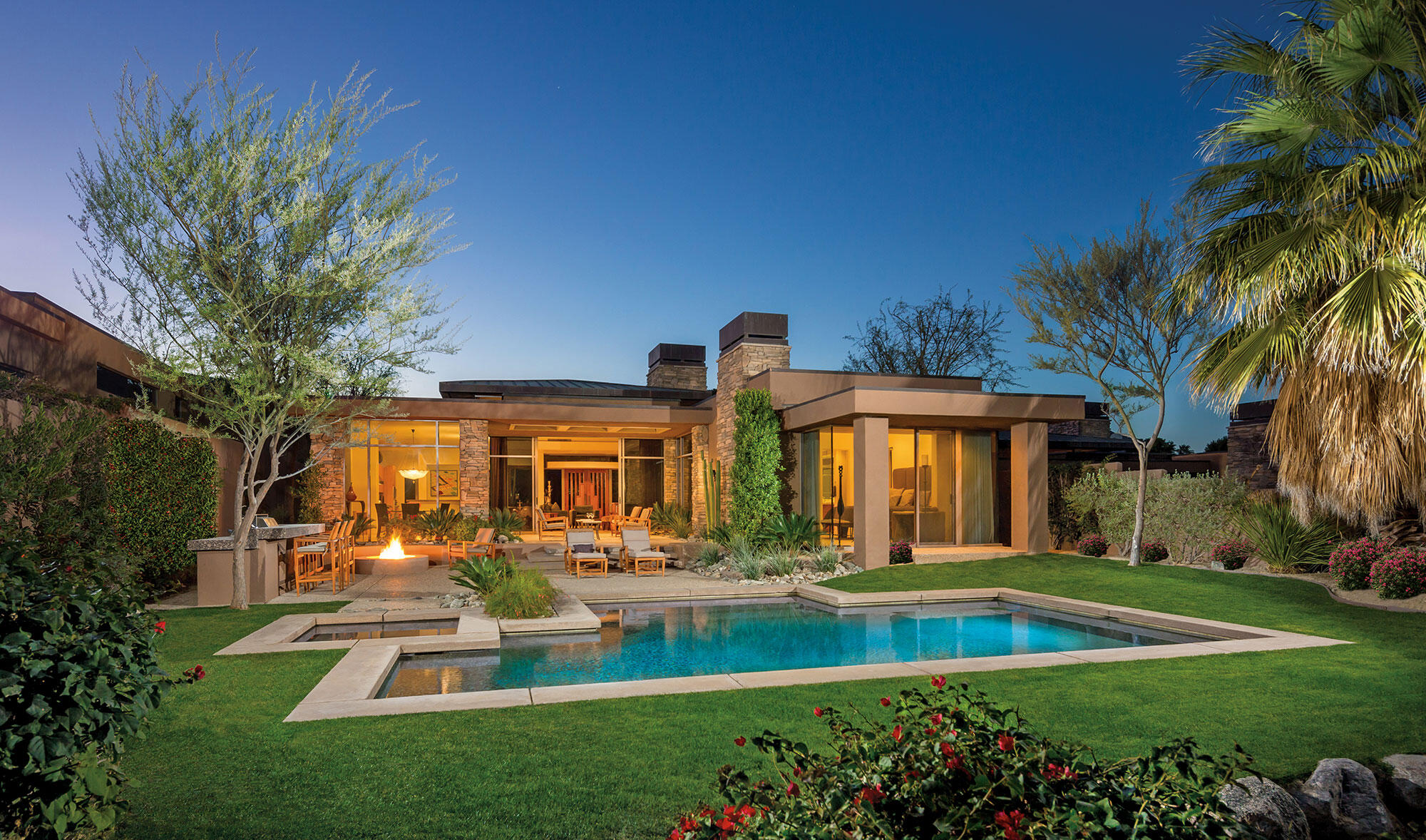 An idyllic setting with running stream, mountains and a private putting green in view from all of the living areas. This desert contemporary home offers seamless indoor-outdoor living. A spacious great room floor plan for casual living and entertaining which opens to the kitchen with an expansive morning bar, center island and high-end appliances. Spacious master suite with fireplace and glass sliders that open to the pool and spa. Two interior guest suites with full baths and glass sliders to entry courtyard. Also a private entry guest house with media center, morning bar, bath and walk-in closet. The covered outdoor living room with lounge seating is an extension of the indoor great room and is open to the patio with barbecue, dining bar, firepit, pool and spa.