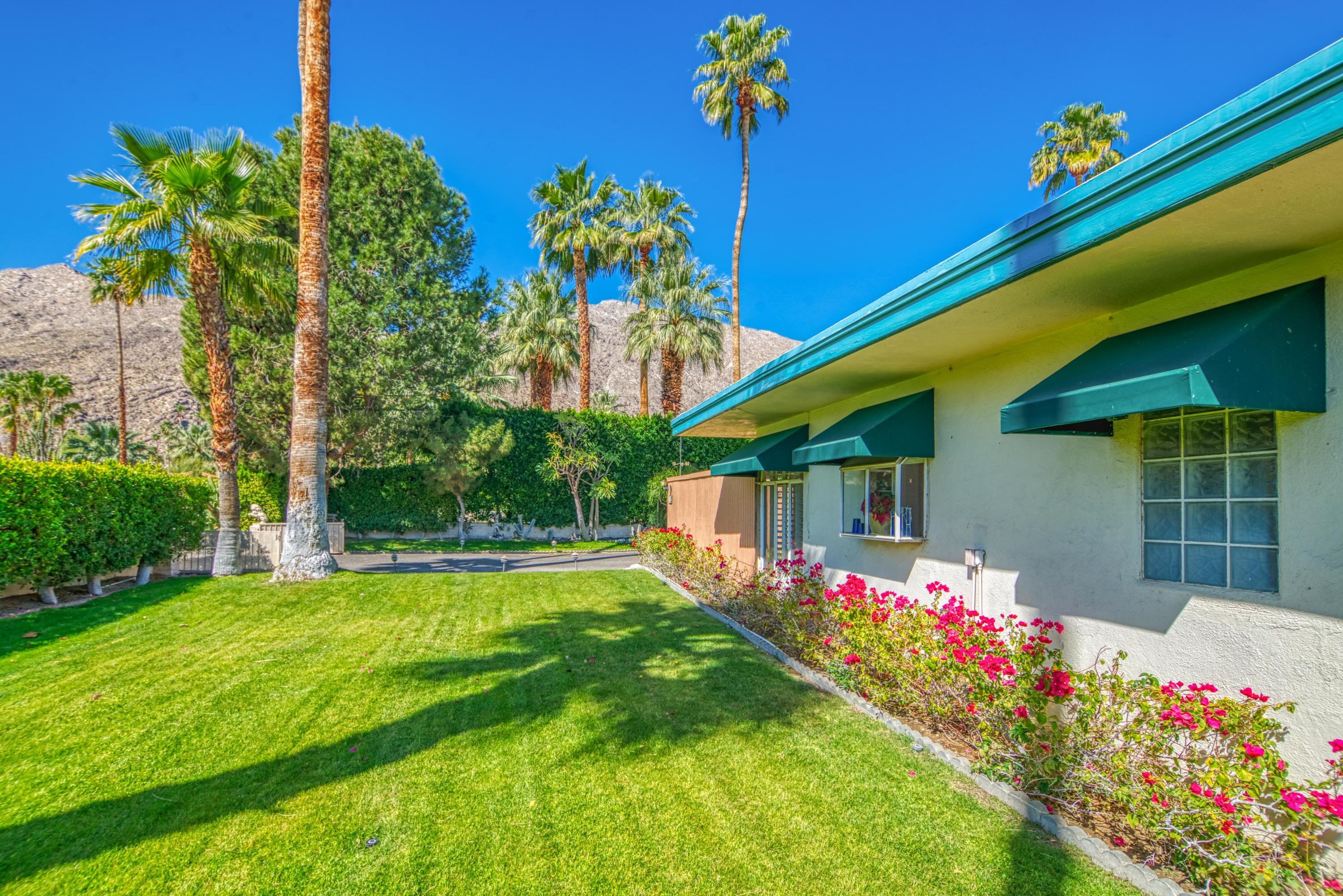 Attention Investors, Contractors, and Mid-Century Enthusiasts!  Are you looking for an opportunity to purchase and renovate a home in South Palm Springs that is located within a block from South Palm Canyon Drive's restaurants and retailers?  If so, come check out this one today!  Located on land you own in Tahquitz River Estates, this 3 bed (possibly 4 bed) home with recent upgrades including a freshly resurfaced driveway, newly installed roof, and a re-plastered pool is ready for you to take to the next level!  Highlights include the front and back yards that offer mountain views, the south-facing private courtyard that leads to the front door of the house, the living room with fireplace, and the adjacent dining room that connects to the south-facing kitchen that has views!  Inside laundry room plus access to the side yard, too!  Master bedroom has a sliding glass door that opens to the pool, a walk-in closet plus separate wardrobe closet and a private bath with walk-in shower. Bedroom Two and Bedroom Three are close to the hallway bathroom.  The separate family room with a walk-in closet (optional Bedroom Four) has views and doors that open to the large pool and private backyard.  Attached carport, too!
