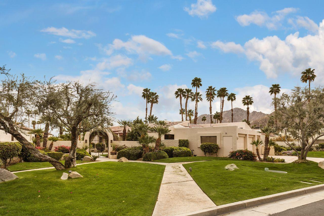 This rare, detached freestanding condo is one of only six Gatsby units; a gated, beautifully landscaped and maintained enclave built inside the gated community of Indian Wells Country Club. It itruly feels like a single family home and is larger than many. This approximately 3900 sq. ft. condo has 3 large bedrooms and 3 baths. Each of the 2 master suites and the roomy guest suite has an attached bath, roomy closet and access to a private patio. The very large living room features volume coffered ceilings and a double-sided fireplace shared by the family room with wet bar. The kitchen area boasts like-new stainless appliances, a light bright breakfast room with a breakfast bar, lots of extra storage in the built-in buffet and convenient access to the formal dining room which is currently being used as an office. The sparkling pool and spa are just steps away from the back patio and for the exclusive use by only six owners and their guests. Other features include newly installed roof, tankless water heater, and a 2-car plus golf cart garage. In addition there are 6 patios with this home. Each living space has an outdoor space of its own. As a property owner in Indian Wells you receive many resident privileges such as discounts at local restaurants, hotels and the Indian Wells Tennis Club, and golf at the Indian Wells City Course. Living in Indian Wells is a relaxed & enjoyable lifestyle.