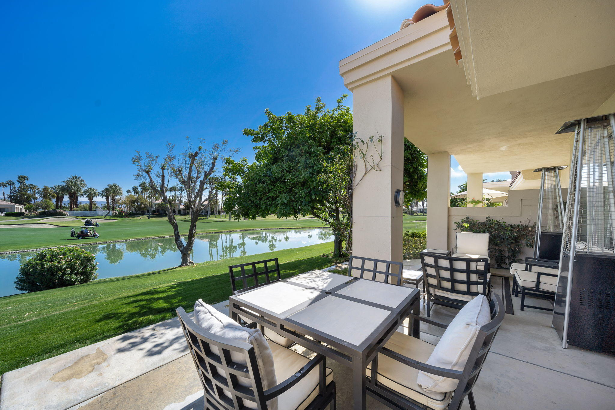 Located behind the Private Palmer gate at PGA West!  Popular Champion 4 plan overlooking the 8th fairway & lake offering relaxing sunrise views!  Front entry leads to the spacious  living room with fireplace, shutters and wet bar.  There is a dining room that leads into the kitchen with granite slab counters & stainless appliances.  The primary suite had its own private patio, plenty of closet space, soaking tub, & double vanities.   Steps away from the community pool & spa!  Offered furnished!