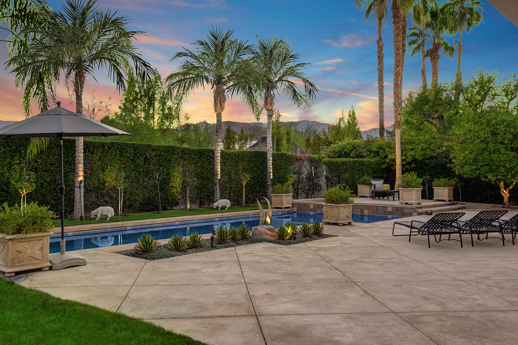 This extraordinary custom contemporary home is in the intimate and private gated community of La Residence in Rancho Mirage. It sits on .49 acres with stunning southern mountain views. The property backs up directly behind the Annenberg Estate.  Enjoy the privacy of this open and spacious floor plan with high ceilings throughout, spans 5,599 square feet with 5 bedrooms all ensuite, with one of the bedrooms currently being used as an executive den with two built in desks and shelving. The expansive master bedroom features a fireplace, an oversized walk-in closet, dual bathrooms and an attached room that can be used as a gym or an additional office. Guests will enjoy staying in a private casita with a kitchenette, walk-in closet and its own separate entrance off the main entry courtyard with a lovely water fountain as you make your way to the main entrance through the clear glass french doors. Kitchen is expansive with a separate breakfast area, there is a formal dining room, living and family room all leading out to the magnificent backyard with pool, spa and mature landscape with an extended covered patio. Travertine flooring, multiple fireplaces, dual laundry rooms, 3 car garage and the list of amenities goes on. This extraordinary home is well appointed and ideal for those working from home. This stunning home is perfect for entertaining and plenty of room for social distancing.