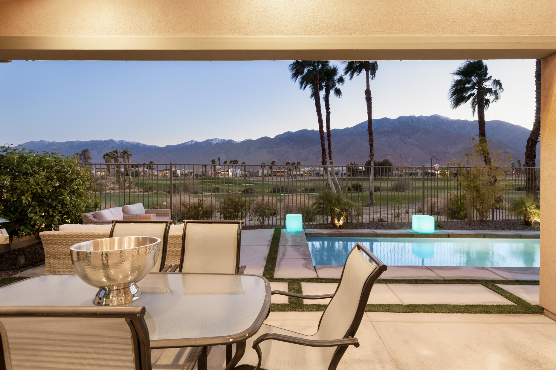 Breathtaking uninterrupted views across the golf course to the mountains.  The back yard has a pool and spa and a covered patio to sit back, relax and enjoy the views. The home  has a great room with vaulted ceilings, two walls of glass that slide back to give the full indoor outdoor living experience, one off the living and one off the kitchen area to the center courtyard. The reconfigured kitchen has a massive center island turned to face the views, off the kitchen is the laundry/utility room.  2 bedrooms and a den, the master is positioned at the rear of the home to take advantage for the views and give access to the pool and spa. The guest bedroom is located at the other end of the house for privacy.  The glass walled den also has a wall of sliding glass panels that open to the center courtyard.  Tiled throughout except the bedrooms, this home is perfect for full time residency of a fabulous part time retreat compete with direct access to a two car garage.  Solar ready with a thankless hot water system