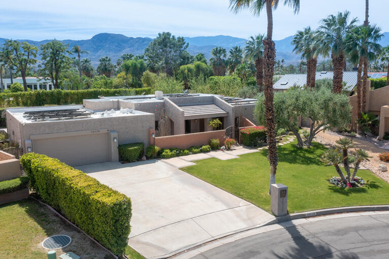 Gorgeous, SOLAR OWNED home, situated in the Tamarisk Area, one of the most desirable  locations in Rancho Mirage, with NO HOA fees!  Over 3000sf of Updated interior living space, with 3bd/3ba + Den/Library/Office (could be be Bdrm #4).  Formal Living Room has high ceilings, & gas fireplace. The wet bar, is open to both the Living Room, formal Dining Area and Great Room that includes a bright updated Kitchen, Casual Dining Area, and Family Room with gas fireplace. Adjacent Butler's Pantry plus Laundry Room has direct access to the attached, and newly Air Conditioned 2 car garage.  South facing Master Suite with direct access to the backyard, features 2 walk-in closets, retreat area, private office space, and updated bath that features dual sinks, walk-in shower, and separate tub. Bdrm #2 Is adjacent to a nicely appointed hall bath with dual sinks, plus tub/shower. Bdrm #3, at the opposite end of the home, accesses a hall bath with separate door to the backyard, doubling as a ''pool bath.''  The ultra private backyard is an OASIS, with Salt Water Pebble Tech Pool/Spa, covered patio, cozy outdoor Fireplace, Mountain views and beautifully manicured lush landscaping.  Recent Upgrades include: Owned Solar, Pool conversion to Salt Water, updated pool equipment, updated landscape lighting, timers & transformers, AC in garage, upgraded home Security System with cameras, 3 new Nest Thermostats, and much, much more. Great Opportunity to own in this prestigious area. A MUST SEE!