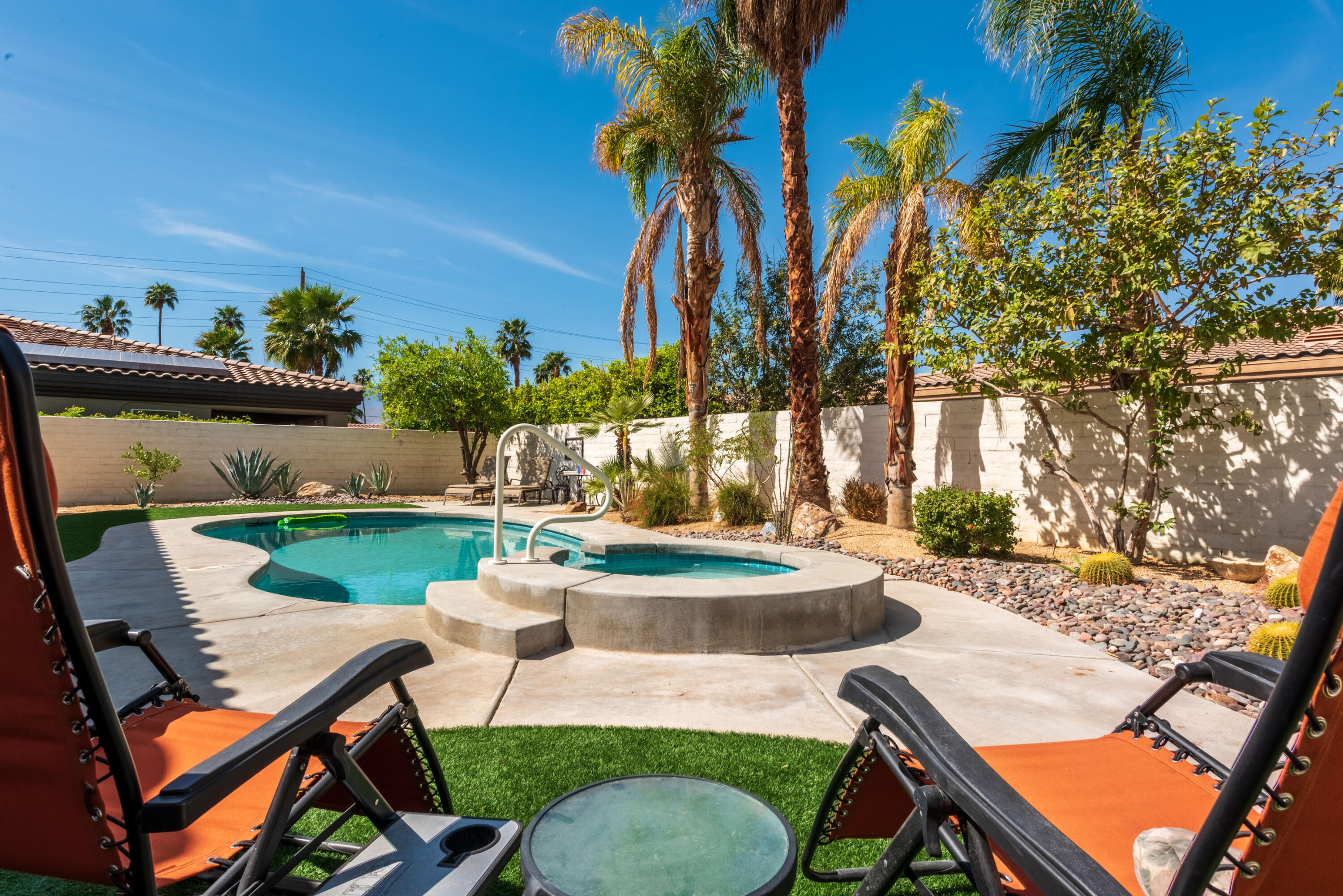 SUNNY back yard/pool! Great central Palm Desert location, perfect for full-timers or snowbirds. This home sits on a large 10,019 lot on quiet cul-de-sac in the highly desirable ungated Hovley Lane West area (with no HOA dues). This spacious, upgraded TURNKEY FURNISHED 2,420 square feet home provides you with 3 bedrooms, 3 bathrooms, an open concept floor plan, fireplace in the large family room, primary suite with separate soaker tub and shower and large walk-in closet, and a kitchen with slab granite counters, in sink hot water dispenser, a center island with a gas cook top and a breakfast bar. Once you step outside the kitchen and family room, you'll fall in love with the entertainer's backyard, complete with large covered patio area with a misting system, built in BBQ, pool, and spa with pebble texture finish and mountain views. As an added bonus, a wide double gate allows access to the side yard with a pad for RV PARKING. Centrally located in Palm Desert, situated between Monterey and Portola for easy access to El Paseo, McCallum Theatre, College of the Desert, Desert Willow Golf Resort (where Palm Desert residents can golf for discounted greens fees), nearby shopping and dining, and many of the Coachella valley's attractions and events.*BMW convertible available outside of Escrow.