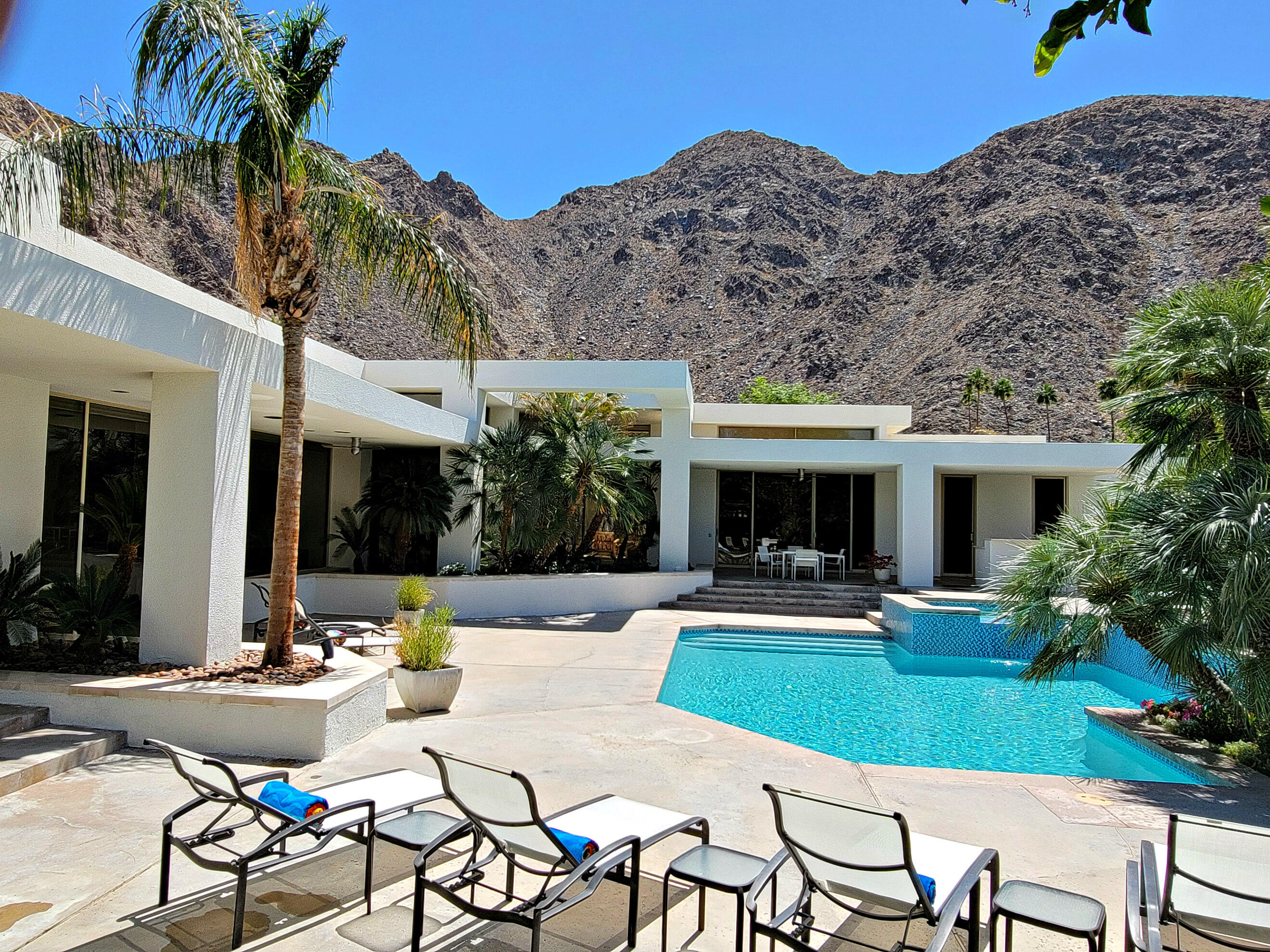 Nestled against the Rugged Santa Rosa Mountains behind the gates of the Prestigious Indian Wells Country Club you will find this Fabulous  Architectural Masterpiece.  Custom Designed for Celebrity Client, Tenor, Enzo Stuarti,   ''Here I find Peace of Mind with Friends, a little Pasta and a glass of wine.''    Breathtaking Entrance welcomes you, Resplendent with rare Crema Europa Limestone Floors reflecting natural light from walls of glass and 15 foot high towering ceilings.  Seemingly endless touches of imported Birds Eye Maple enhance the overall richness.   Large Chefs, eat-in, Island Kitchen with all high end European Gaggenau Appliances. Conveniently positioned Formal Dining Room highlights  the homes wonderful relationship with the outdoors.  Light and Airey exuding a feeling of uncomplicated Palatial  Elegance.  The Master Suite alone is something to behold. with Huge Walk in Closets, Large sunken tub Generous His and Hers Vanities. Nearly half an acre of Lush Green Seclusion , Newly refinished Pebble Tech Pool and Spa basking in the shadow of the Santa Rosa mountains.  Two Separate Casitas each with full baths, and their own Private Patios.  Two- yes 2 Car Garages,+Golf Cart Garage. 4 Newer Trane A/C's. Recently redone roof also adds to the amazing value of this fine Residence. Created by Award winning Desert Architect (Vintage Club) Patrick Evan Sheehy.  Built by local Quality Builder Chuck Strother and finished by Feng Shui Master Kathleen Turnpane. NO HOA FEE's