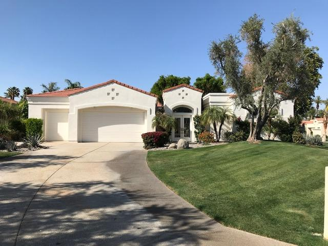 This is a highly sought after and ever popular free standing lakeside Riviera Plan.  This is a desireable home for permanent or vacation living.  It boasts an interior courtyard, detached Casita, exercise pool, mountain and water views.  The corner lot (over 16,900 square feet), provides openness and separation from neighbors.  An inviting courtyard entry welcomes you home.  The tall, double glass front doors, sets the stage for your calming, in-town retreat.  The entertainer's kitchen and family room benefits from a built in big screen TV, sound system, corner fireplace and direct access to the patio and pool.  The large master suite contains a gas fireplace, large walk-in closet, spa-style bathroom and access to the pool and spa.  Two ensuite family bedrooms, with  complete the family living areas of the main house.  High ceilings, wide doorways and walls of glass brings the outside in and provides both abundant light.  There are skylights in the foyer, master suite, dining room and entry from garage that bring in natural light in all areas.  The detached Casita has a three quarter bath and is perfect for a fourth bedroom, guests, staff or office - or distancing.  The home is located on an interior lot and being on a corner, there is only one side yard neighbor.  The two car, attached garage also has a golf cart garage area.  The expansive driveway provides ample off street parking.  Desert Horizons is centrally located and has long been a destination CC.