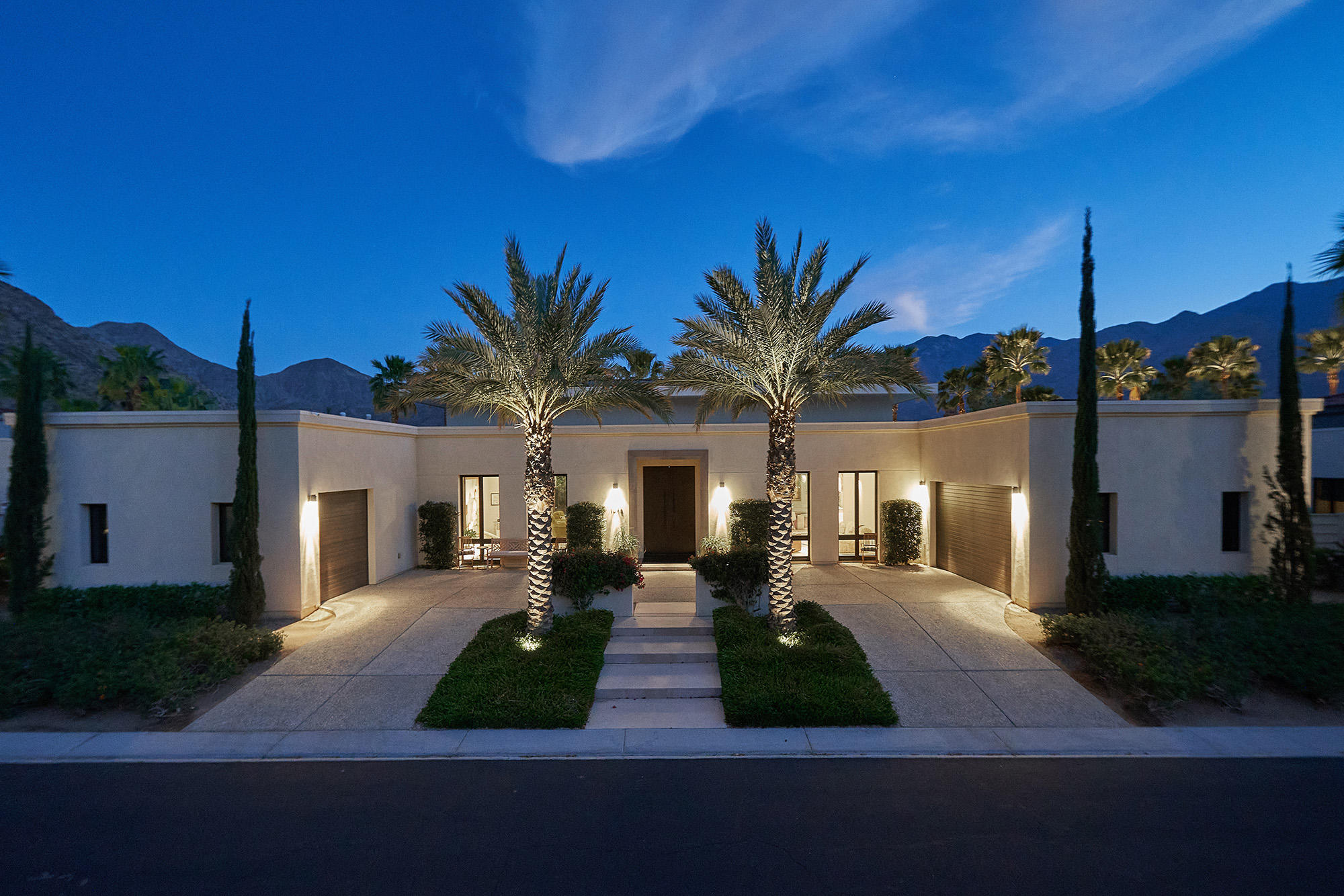 This spectacular and breathtaking architectural 2013 showcase estate has walls of glass and  southern, western and eastern mountain views from inside and out! This highly upgraded home has 4 bedrooms + media room + an additional bonus room! The great room has three sets of Fleetwood sliders that open up to the very private resort backyard which includes a swimmer's pool, spa, firepit, outdoor kitchen, outdoor shower, cabana with misting system and lush landscaping with fruit trees. The Epicurean kitchen has two separate islands, two wine coolers, Italian glass cabinets, high end appliances including an ice maker, warming drawer and built-in coffee maker. There are two fully paid and owned solar systems that total approximately 26KW! Other upgrades include 4 Tesla Power Walls providing full home backup in case of a grid power outage, Tesla car charger, whole house high efficiency air cleaner plus germicidal UVC lamps on all HVAC units, whole house water filtration system, Nuvo audio including outdoor speakers and split air conditioning in both garages! Located in South Palm Springs on fee land (you own the land) in the guard gated community of Monte Sereno!