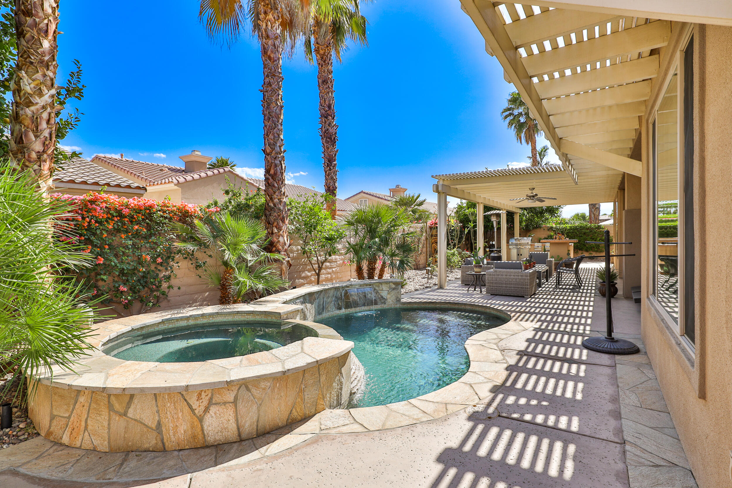 This gorgeous home is located in Sun City Shadow Hills, an active 55+ adult community & shows pride of ownership. With 3BR/3.5BA (includes a 1BR detached Casita w/ bath), den can be 4th BR & approx. 2966 SF (La Paz model) of fabulous! Relax & enjoy the sparkling pool/spa in the entertainer's yard w/an outdoor kitchen, BBQ, warming drawer, burner, sink & large Alumawood overhang. There is a TV & an outdoor shower. The newly remodeled kitchen has stunning quartz counter tops & a stone backsplash w/dark cabinets, glass doors & a spacious walk-in pantry! Gorgeous formal dining room with elegant chandelier & a Butler's pantry. The sumptuous master suite is on one side of the home for complete privacy! Master bath has a spa shower, dual sinks, a vanity & the walk-in closet is huge with built-in shelving as well as drawers. The home is painted in lovely gray tones, w/ crown moldings throughout, ceiling fans & 6 newer TV's. Indoor laundry room has a sink. The 3-car garage has epoxy flooring & plenty of cabinet space. This popular adult community offers 36 holes of golf, state of the art fitness center, restaurant, tennis, pickle ball, bocce & numerous clubs, social activities, a 35,000 sq. ft. clubhouse w/state-of-the-art fitness center, indoor & outdoor pools/spas, tennis, bocce, billiards, special events & so much more! The Shadow Hills North Course has 18 holes of Par-3 while the South Golf Course provides 18 holes of Award-winning, championship-level golf. Beautifully furnished!