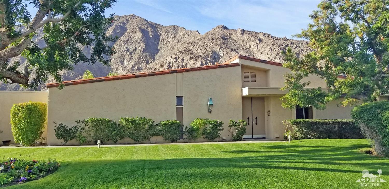 This 2,008 SF, 2 bedroom, 2 bathrooms condo is located inside the gates of the prestigious Indian Wells Country Club. The spacious kitchen opens to the large living room and dining area with magnificent views of the mountains and views of the golf course and community pool and spa. The living/dining room features a west bar for entertaining, vaulted wood and wood beam ceilings and a cozy stone fireplace for the cooler evenings in the desert. Both bedrooms open into a private enclosed atrium and have access to the 2 car garage plus golf cart garage. This furnished condo is perfect for year-round indoor/outdoor entertaining and the ultimate desert lifestyle. In addition to 20% discounts on food & spa service, Indian Wells residents can golf at Indian Wells Golf Resort for reduced rates.