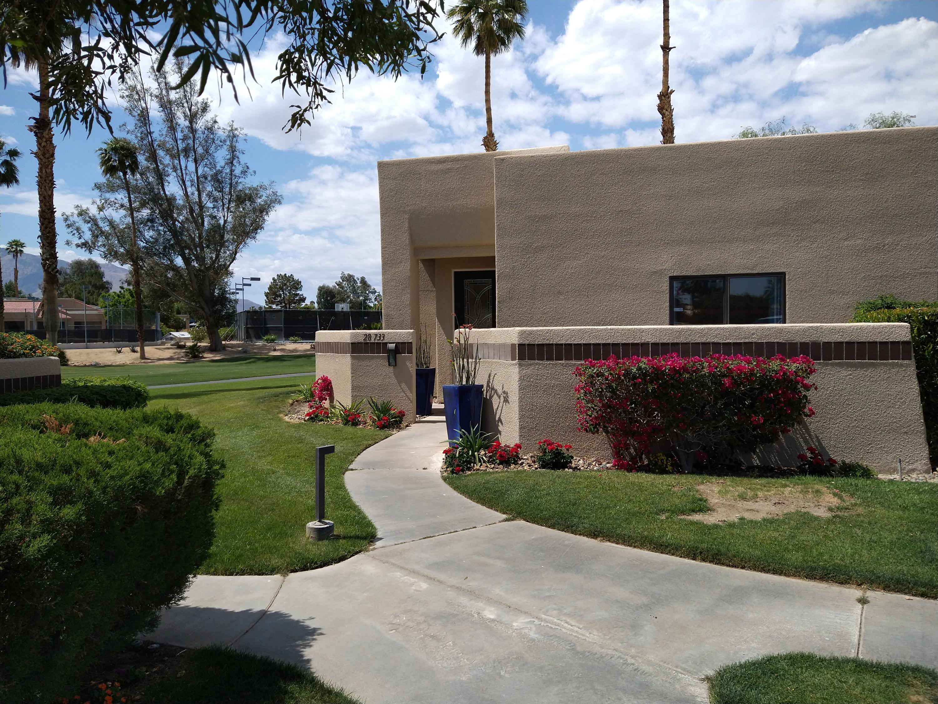 Completely remodeled 2 bed and 2 bath condo on the golf course with views galore. This unit is conveniently close to the club and all the facilities Desert Princess has to offer. Beautiful updated landscaping leads you to the new magnificent custom entry door with leaded glass. The living room is open and inviting, offering high ceilings, recessed lighting, custom tiled fireplace, new high end laminate flooring throughout, new base and case molding and more. The living and dining space is open to a beautiful new custom kitchen with gorgeous quartz countertops and tiled backsplash. There is a  peninsula with counter seating, high end stainless appliances including a Bosch dishwasher. The kitchen sink overlooks the rear patio and greenbelt. This desireable floorplan has a nice separation of bedrooms. Both the guest and master bedroom have recessed lighting, ceiling fans, large closets with newly built interiors. The completely remodeled baths feature beautiful custom tile, new cabinetry, quartz counters, brushed nickel faucets, dual sinks in both and in the master a new glass enclosure for the oversized shower. There is a laundry closet that has a full size washer and dryer. With this unit there is a single car garage with a roll up sectional door. This unit is beautiful and no doubt won't last.