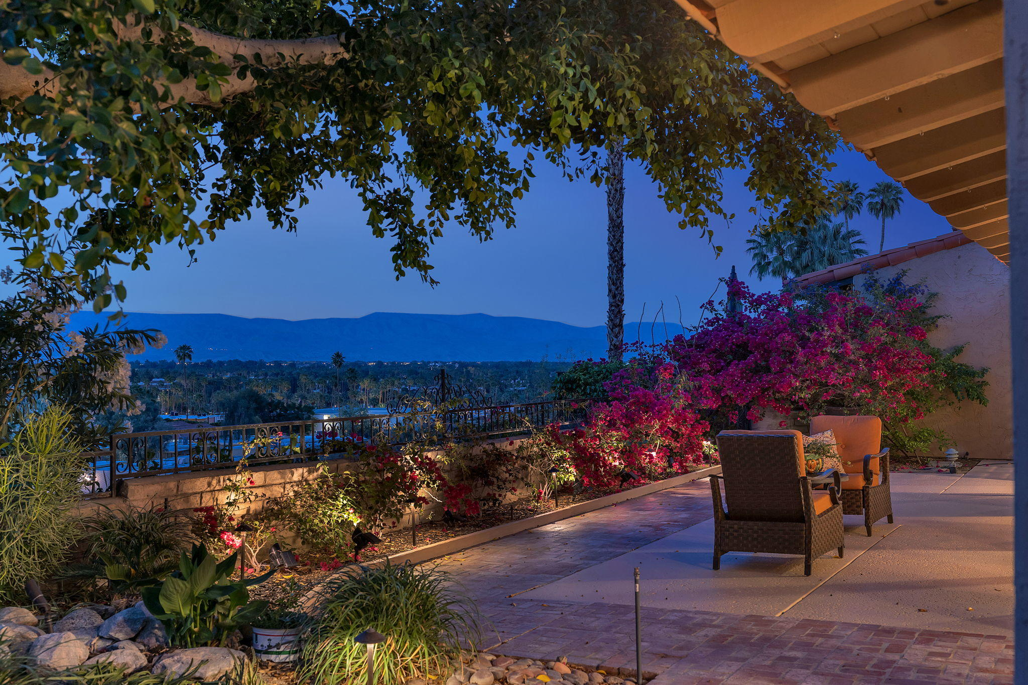 Enjoy quiet nights and city lights from this premium hillside location.  The views from the interior and wrap around patio extend across the valley floor to the San Bernardino Mountains.  The sleek designer finishes and energy efficient upgrades validate that details make the difference. An expansive foyer with Glass Art Chandelier and skylights welcome you to the light filled interior with wall-to-wall glass sliding doors.  A vaulted wood beam ceiling, tile floor throughout and Great Room design  will compliment traditional or modern furnishings. A DREAM Kitchen beckons those who LOVE to COOK and/or entertain. DACOR gas range, Fisher-Paykel Dishwasher Drawer, Granite counters, Center Island, an abundance of cabinetry/storage and VIEWS overlooking the pool/spa. Two bedrooms have remodeled En Suites and direct patio access.  The spacious third bedroom is currently used as home office/den with direct pool/patio access. High HVAC efficiency systems with Allergan filters, Evaporative Cooler, Water Heater, additional ceiling insulation and heated floor in the Master Bathroom are just a few of the upgrades in 2018..  The true highlight is enjoyed outdoors.  A wrap around patio offers an abundance of sun or shade as you enjoy the private pool and spa.  It's peaceful and quiet and the VIEWS are breathtaking. This private enclave, with golf cart access to Thunderbird CC, offers a unique Lifestyle in the Heart of Rancho Mirage.