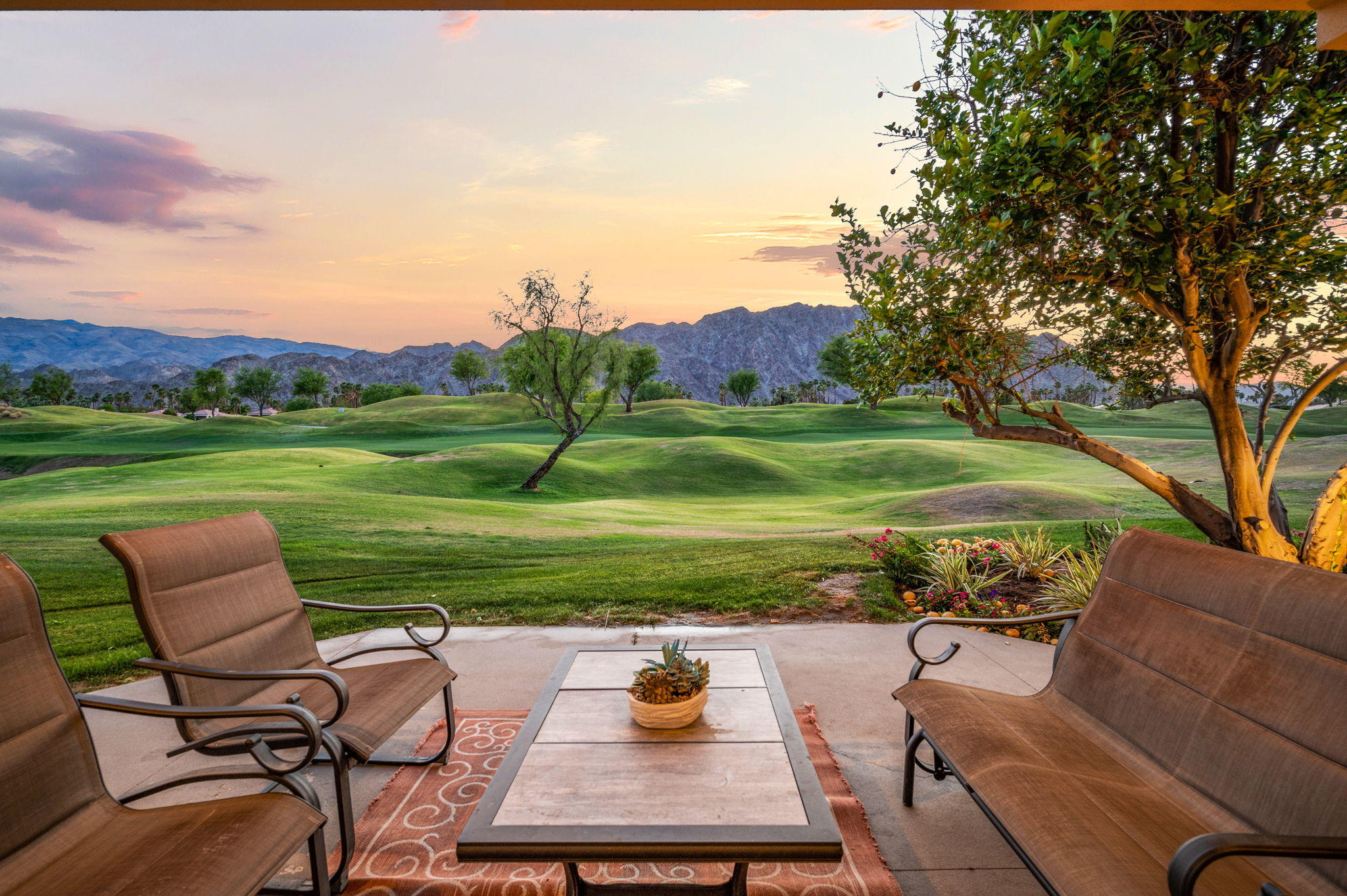 This stunning contemporary home will enchant you with magical sunsets and picturesque views of the rolling double fairways and Santa Rosa mountains in the distance. The interior features fine finishes and accents throughout, high ceilings, and ample window space to enhance the light and views. There are three bedrooms each with its own en-suite bath, an additional space to use as a study or office, and a living room wet bar as the perfect addition to entertain guests with views to the fairway and mountains. The enclosed side yard is ideal for those with a family pet and is large enough to build a private pool if desired, or take advantage of the community pool across the street, just steps to your morning, afternoon, or evening swim. Whether as your primary residence or second home, enjoy some of the finest in desert living at this PGA West gem.