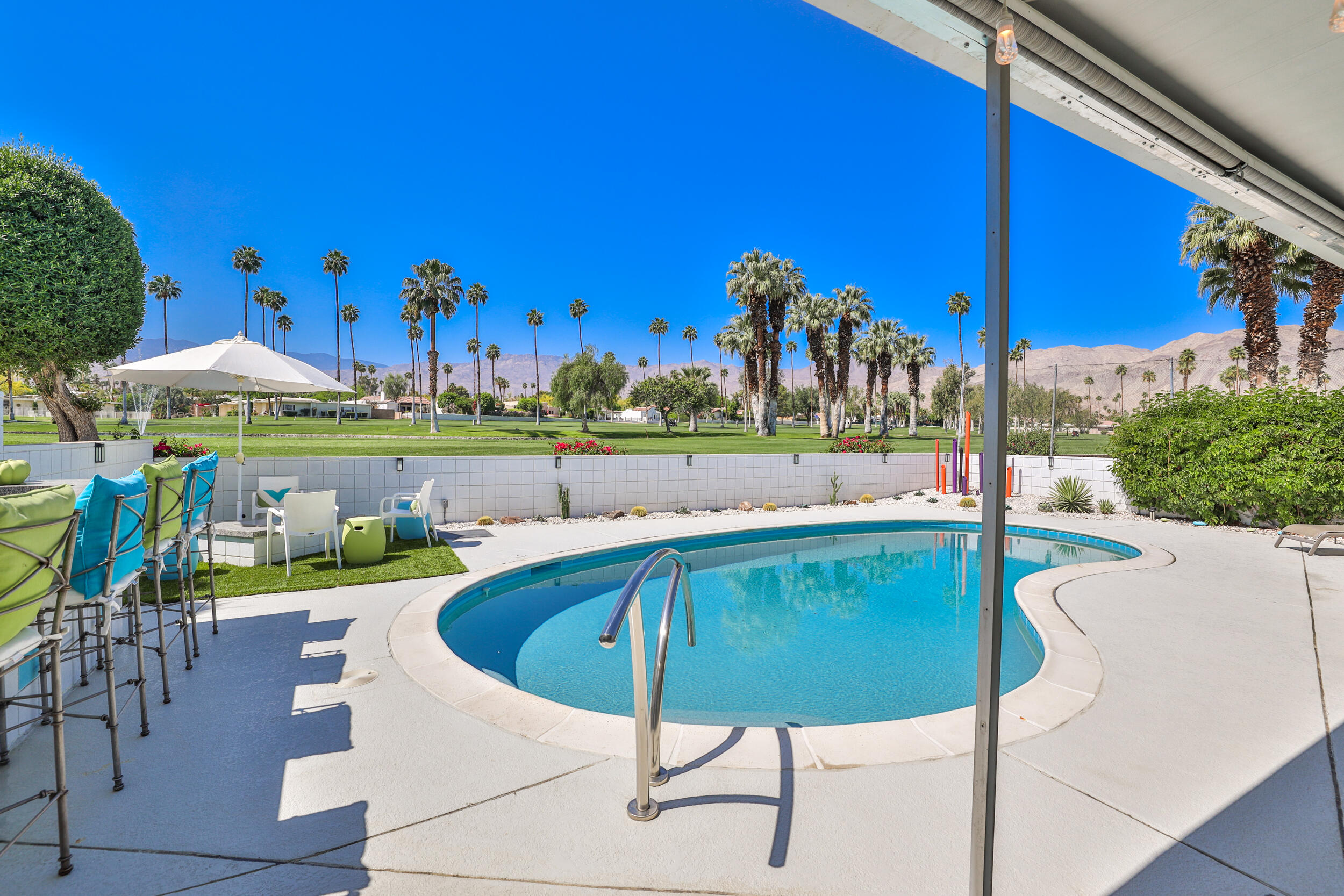 One of a kind!  Mid-century modern condo (Wexler/Harrison team 1962) in South Palm Desert, located on the golf course of Shadow Mountain resort and club. South facing patio with breathtaking views of the mountains, greenbelts, lake and fountain.  The north facing views overlooking the golf course and mountains from the guest bedroom and living room are spectacular.  This condo is beautifully updated with new windows, floors and bathrooms.   Kitchen is refurbished, has modern appliances with a beverage fridge. Separate laundry room has extra storage and a wine cooler.   The living room is bumped out, which could be converted to a 3rd bedroom or den.   The large patio offers a lot of room for entertaining around a sparkling salt water pool.    Very low HOA fees , includes front landscaping, trash, exterior paint and earthquake insurance.   Turnkey furnished per inventory. Walking distance to El Paseo! Come and see this unique property!