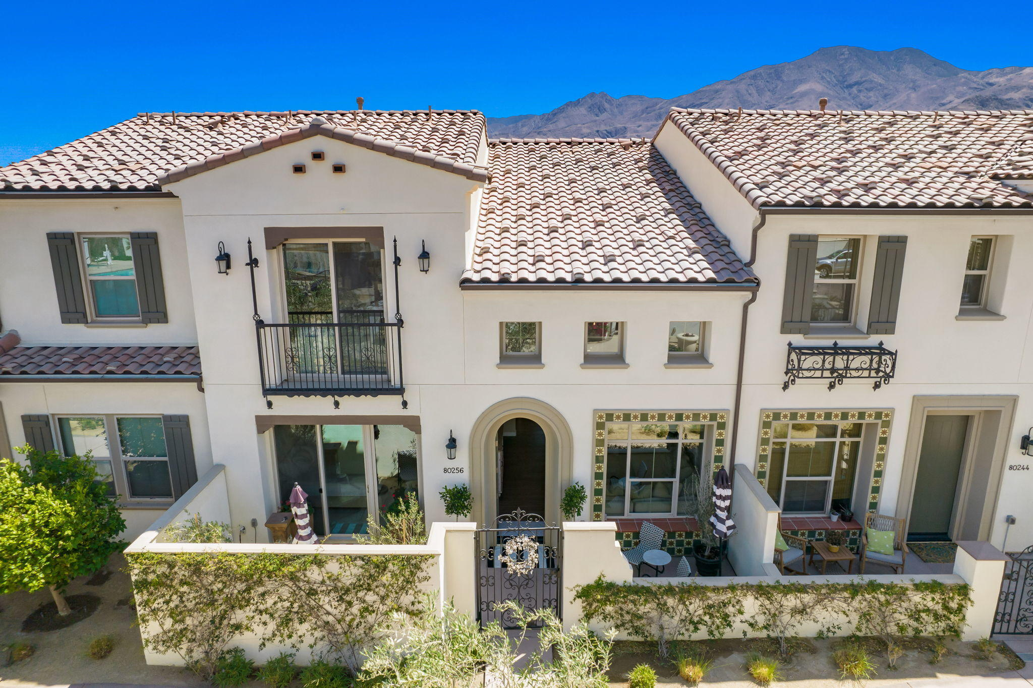 Discover what it means to immerse yourself in true luxury with this immaculate La Quinta residence set within a prestigious community. From the moment you step through the arched door into the light-filled layout, you'll feel this is a special home. A grand open-plan living area stretches before you set under a soaring double-height ceiling with wood floors underfoot and a chandelier overhead. In the kitchen, a center island with a quartz waterfall countertop will appeal to the entertainer while the avid foodie will appreciate the stainless steel appliances that include a dishwasher and gas range. Ensuring utter opulence are the breathtaking lighting fixtures, the plush bedrooms, incredible bathrooms and as a bonus, you'll have a built-in speaker system to always have the right mood.  Your breathtaking abode is set within the enviable Signature PGA West, a new luxurious gated community. As a lucky resident, you'll live within walking distance of the world-class community amenities that include a fitness room, a resort-inspired pool, and a clubhouse with golf and tennis. Isn't it time you treat yourself to this life of total leisure?