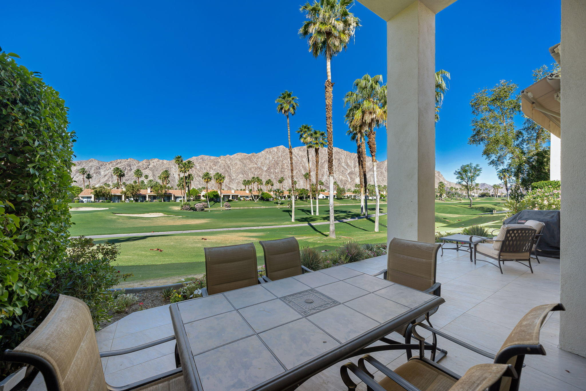 Owner will trade or carry!  One of the best views in PGA West!  Overlooking the 7th Fairway of the Palmer Private Course and surrounded by the stunning Santa Rosa Mountains!  This popular Champion 4 is beautifully appointed with porcelain tile wood style flooring, fresh white paint throughout, recessed lighting & fixtures. The wall has been opened between the kitchen and living room for that great room feeling!  Updated bathrooms are finished with fresh white cabinetry, new sinks & faucets!  There is a formal dining area for family dinners or step out back to the extended patio with plenty of room for outdoor entertaining!  You will want to see this one! Offered Furnished!
