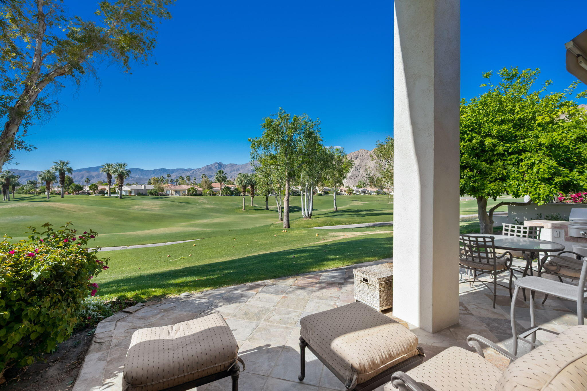 This one of a kind AMAZING Champion 3 offers  A++ southwest, lake and panoramic mountain views, which are night lit for the Ultimate PGA WEST experience! Located on the Signature 4th Hole of the world-famous Arnold Palmer Private Course at PGA WEST this condo offers 3 bedrooms and 2 1/2 baths. There is also a separate bonus OFFICE/BEDROOM with double trundle bed added in the back courtyard with it's own A/C and sink. There are many top notch features in this light and bright unit. High ceilings, recessed lighting, Hunter Douglas Plantation shutters, crown molding, stylish ceiling fans, tile flooring in living areas, stone countertops, and remodeled bathrooms, including a large tiled walk-in shower in Master. Remodeled kitchen features Stainless Steel appliances, gas cooktop, dual sinks, replaced white cabinetry, and Breakfast Bar. The Living Room in this elegant and quality appointed home is enhanced with a beautiful stacked stone fireplace, built-in cabinetry, and maximum windows to enjoy the stunning views. Additional upgrades include an added powder room, new water heater replaced in 2018, air conditioner and heaters replaced in 2016, and upgraded Stainless Steel BBQ Island. This PGA WEST home is a rare find. Sold fully furnished per inventory.