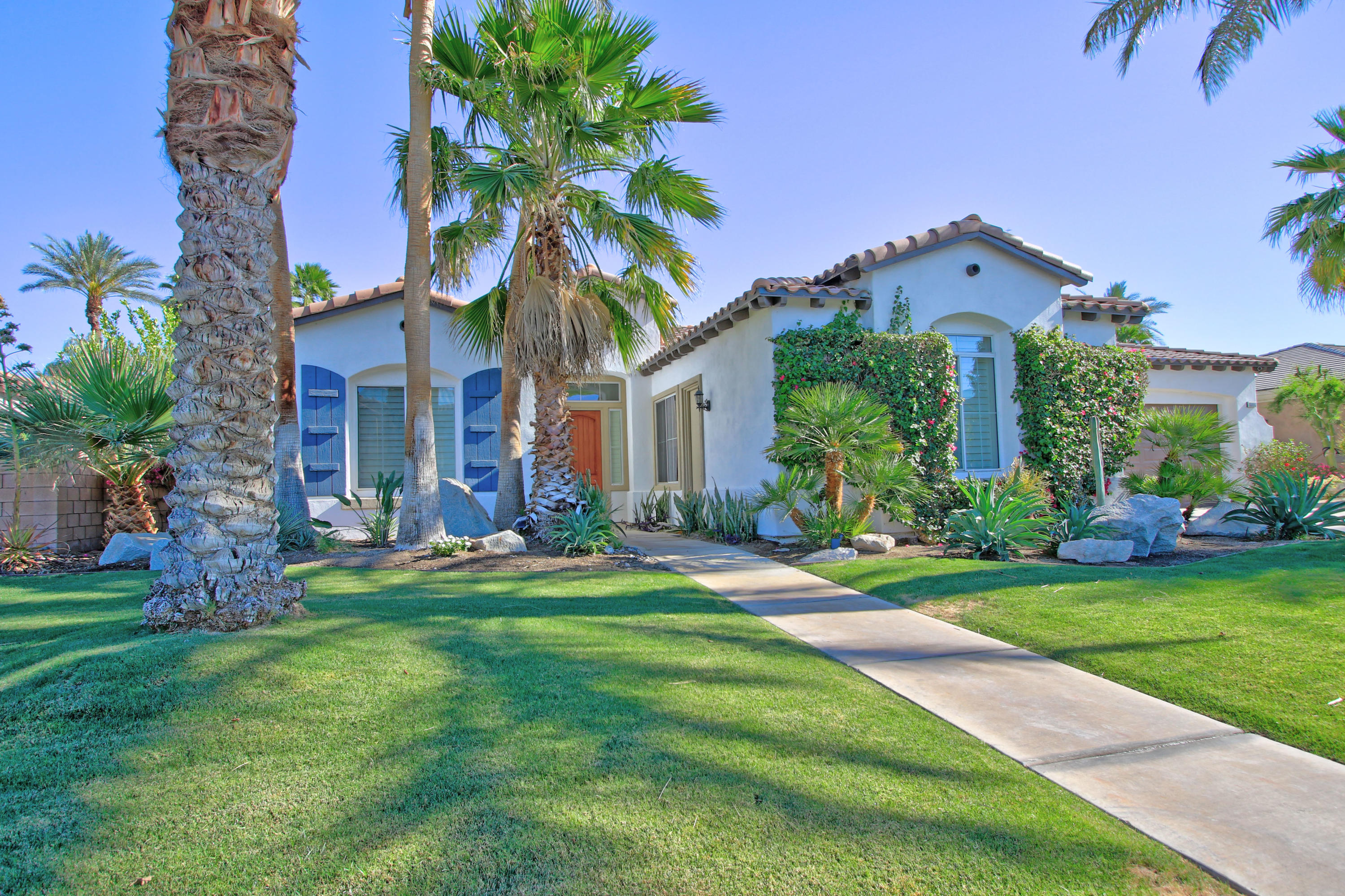 Really nice home at The Orchard, a gated community with low HOA's located off Avenue 49, one of the prettiest streets in Indio.  Seller did some gorgeous remodeling and now has to move!  The 4th bedroom has been remodeled to become a large Bonus room, which is currently used as an office.  There was an incredible kitchen remodel with Quartz counters, huge island, open shelves and new appliances.  Other features you'll love include the New floor, cabinets, tiled fireplace and stove hood, new doors, new hardware, fans, Nest system, new hot water heater, interior paint and more.  The over sized lot is beautifully landscaped, features a firepit and a lovely covered porch, with lots of room for a pool.  The furniture is included per Sellers inventory list at List price.  Minimum 30 day rentals + 18 days over festival weekends (buyers to confirm with HOA)