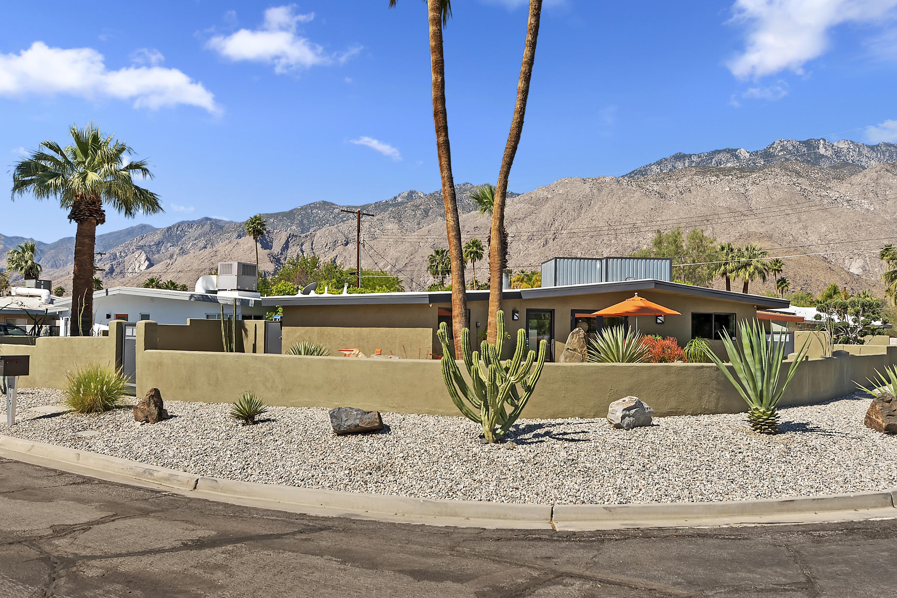 An Alexander Style Mid Century Modern STUNNER! Located in the coveted Movie Colony East, originally known as ''Winterhaven Manor'' area developed by the well known developer Jack Meiselman. I LOVE this home! It truly captures the essence of Palm Springs living.  It's the perfect paradise setting for work or play, the true Palm Springs lifestyle! Located on a corner lot with HUGE Mountain Views and wrap around front patio w/ custom designed landscaping that gives you several choices to entertain or relax. Complete Remodel from modern quartz counters to futuristic light fixtures. Popular open floor plan from living room /dining area that blends seamlessly into the kitchen.  Large primary suite with sitting area overlooking our prized mountains and your beautiful pool w/ custom multi color lights & soothing water feature spillover. Second room is a junior guest suite with your own private bath. Third room has been made over into an office dream work area with custom modern cabinets & desks. Upgrades include: New pavers in the backyard, pool remodel w/ newer pool filter, newer foam roof, newer HVAC system w/ new grills, newer tankless water heater & retractable awning with new cover and motor over your parking area plus much more, see list of upgrades. This is a truly enchanting property perfect for the Mid-Century modern enthusiast, you will not be disappointed. Start enjoying yourself with friends and family or use it as a ready-made Airbnb - short term vacation rental.