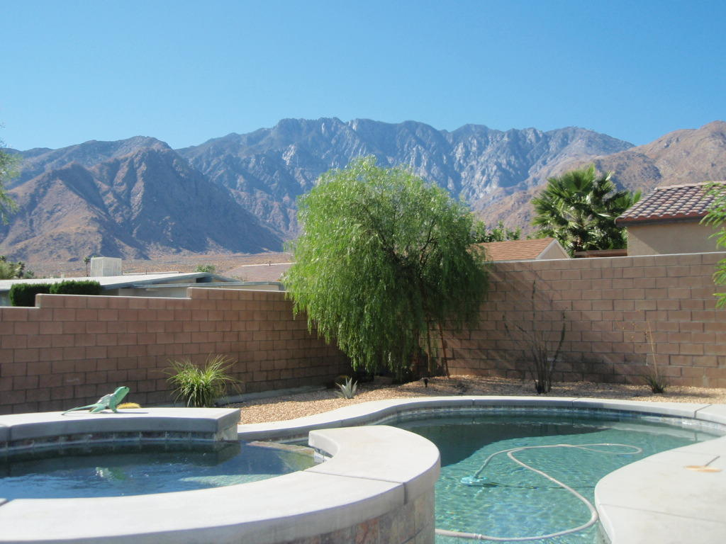 Gorgeous pool home with views of San Jacinto Mtns. 2 BD, 2BA, home painted in neutral colors. Great room floor plan, large kitchen with special lighting over big kitchen island. Great room and master bedroom have built in speakers in ceiling, 2nd bedroom is wired for sound also. Flooring is an upgraded porcelain tile. Inside laundry room. Enjoy your own private pebble tech pool while taking in the breathtaking views of our mountains. Located in gated community minutes from downtown, close to shopping, restaurants, recreation, and the Tram. Super Low HOA's 120.000 a month.  community features 2 tennis courts, basketball court, playground, walking trails, BBQ! area, and roving patrol.