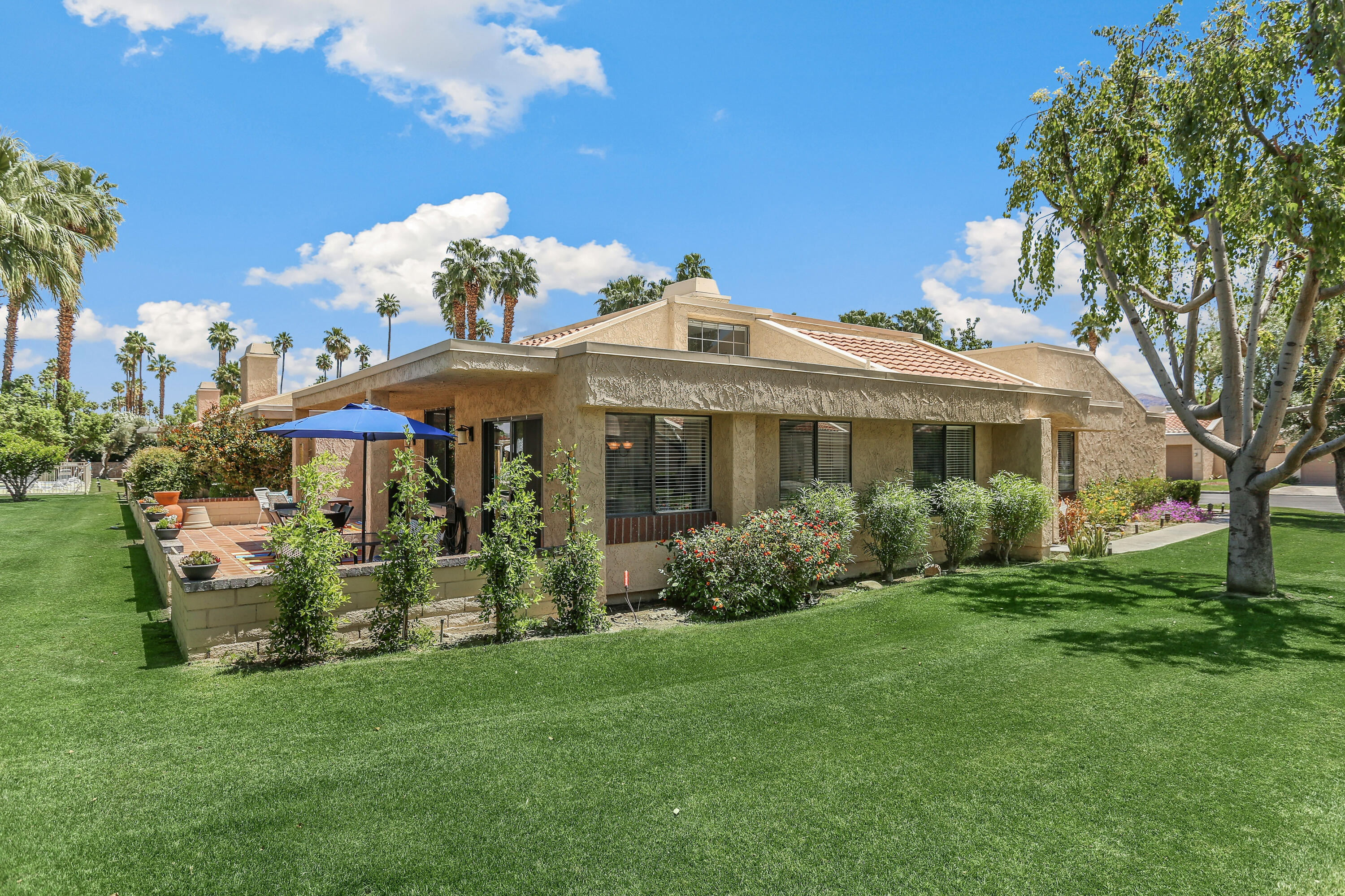 A wonderful offering at Cathedral Canyon Country Club located near all conveniences and minutes away from the Palm Springs international airport! This end unit condo is sitting on an interior location and steps away from a sparkling pool & spa & beautiful manicured greenbelts. The spacious and open floor plan features over 1700 sqft of living space with 3 bedrooms (one being currently used as den) & 2 baths. This bright condo offers high ceilings, an interior atrium, a cozy fireplace, custom window treatments, updated laminate flooring in most rooms & a brand new water heater. Cook a delicious meal in the remodeled kitchen with new cabinetry, quartz slab countertops and newer stainless steel appliances. Outdoors, relax in one of two oversized enclosed patios not to forget a laundry room & a large two car attached garage with storage. For an even easier move, this condo comes mostly turnkey furnished (per inventory). Cathedral Canyon Country club amenities include a golf course, multiple heated  pools, spas, tennis, a clubhouse and the popular Jax restaurant...this is one not to be missed!