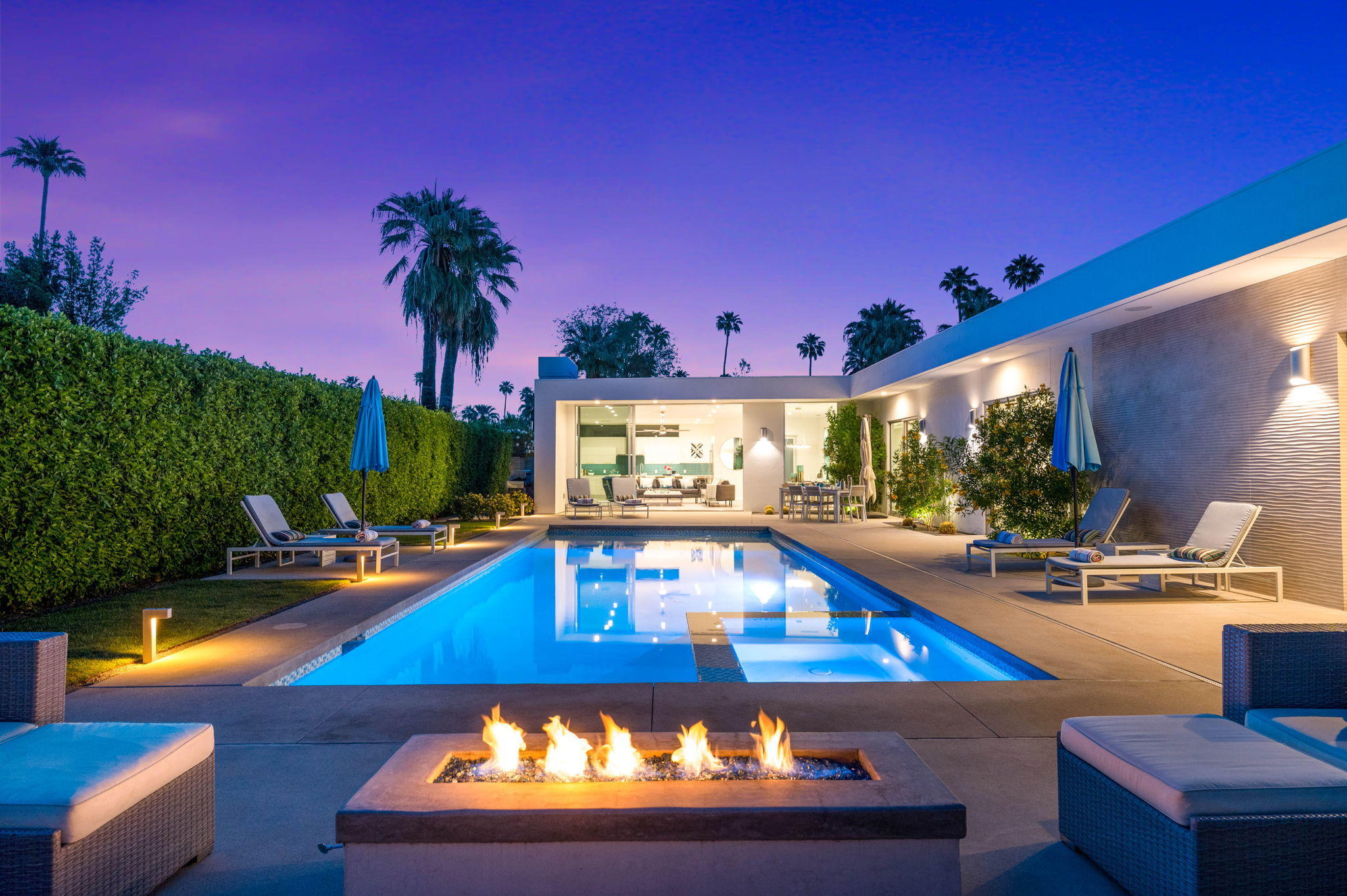 New Century Modern meets Wexler-inspired design. Nestled in the quiet and sought-after neighborhood of Tahquitz River Estates (1 mile from the strip), this newly built (2017) Sanborn and Modlin masterpiece was meticulously designed to scream PALM SPRINGS! The moment you swing open the front door, your eyes shoot miles south through the 10'x16' floor-to-ceiling (stackable) Fleetwood aluminum sliders, capturing the 16'x40' destination pool, gorgeous palm trees, and the jaw-dropping San Jacintos mountains. 3 of the 4 bedrooms have an en-suite bathroom. The 4th bedroom is considered a hybrid room for use as an office or media room. The glass sliders in the hallway offer mountain views the entire journey to the primary bedroom. 8' stackable doors in the primary bedroom offer glorious western views, and you're just steps away from the spa. Property highlights include: 10' ceilings, two car garage, upgraded acrylic stucco on the entire exterior, 16'x6' floating seamless corner window in the great room, 60'' linear gas-burning Crave series fireplace, and gourmet kitchen with Thermador professional stainless-steel appliances. This 2800 sq.ft. home boasts a fully integrated home automation system allowing control of lights, shades, music, pool, spa, security, and more. Many elements also integrate directly with Amazon, Alexa, Google Home & Apple HomeKit for smart-hub and smartphone app control. Short-term rental friendly. YOU OWN THE LAND. Hands down the best active listing in PS.