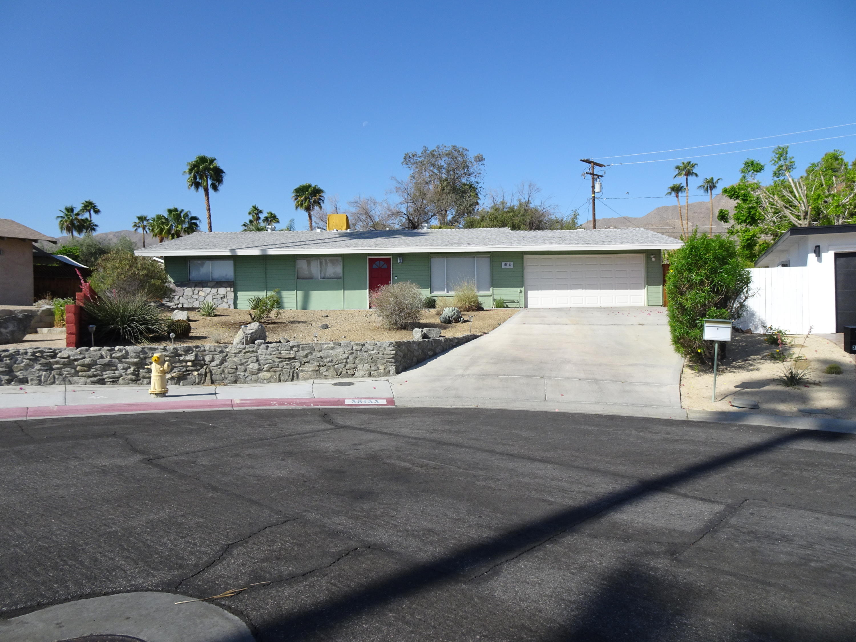 A superior location on an isolated Cul De Sac high in the Cathedral City Cove makes this mid-century jewel the perfect home for any need!  A classic rambler, complete with multi texture façade it sits high upon an elevated lot affording majestic mountain views. The huge fully fenced back yard with pool, covered patio, and Weber bar-b-que makes it perfect for very private parties large and small.  Enter into a spacious great room with vaulted ceilings opened up by the previous owner. An attic space with bevel block windows was also created accentuating the homes mid- century charm. Title records show a 3rd bedroom but it too appears to have been opened up to create a den space. Leave it as is or add a French Door entry and some doors to the existing closet space and ''presto-chango'' it's a bedroom again! Purists will appreciate some of the original mid-century elements remaining throughout the home such as vents, shower and kitchen tile and appliances. Other accents have been added over the years such as a stand-alone sink, black and white basket weave flooring, sconces and other lighting fixtures.  The great room kitchen has been modernized with a stainless island range hood over the gas cooktop. Often overlooked green features include energy saving evaporative cooler and WiFi thermostat. The  garage door opener is super quiet. Minutes from Mary Pickford Theater, City Hall, Civic Center, Restaurants, and the new Aqua Caliente Casino! No HOA!  Make an offer today!
