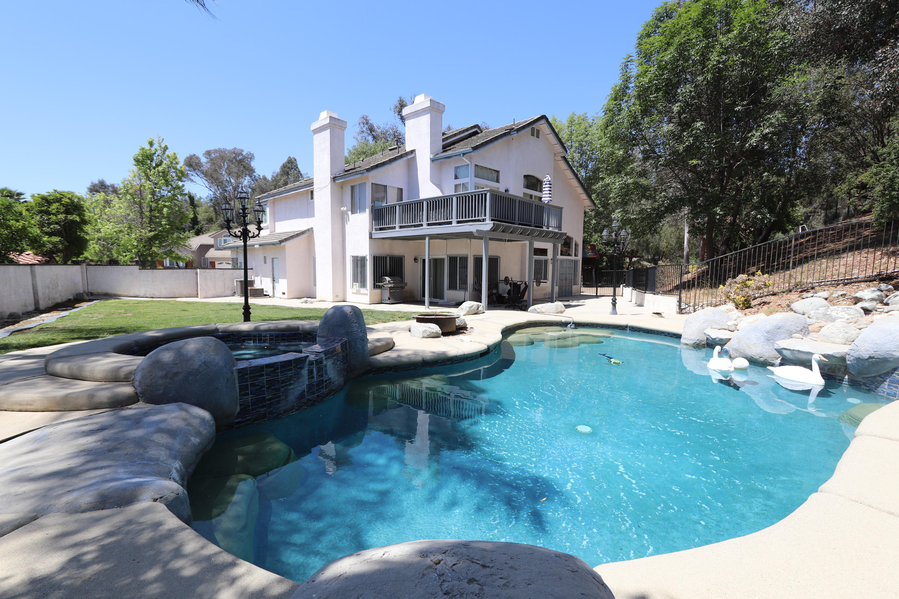 Rare opportunity in Phillips Ranch Area - Hillside Cul-de-Sac home on a spacious 18,000 square foot lot.  Lagoon style saltwater pool and spa.  Views of mature trees, hills, and a valley slope.   This 2 story estate boasts 2,901 square feet of living space, 4 spacious bedrooms, 4 bathrooms, scenic balcony, and gourmet kitchen.  Granite counter tops, wood flooring, 2 fireplaces (1 in the master and 1 in the living room).  Vintage charm with stone accents, 3 car garage, vaulted ceilings, 2 ac units, perfect retreat with lots of potential.  Hiking close by, short distance from dining and shopping.
