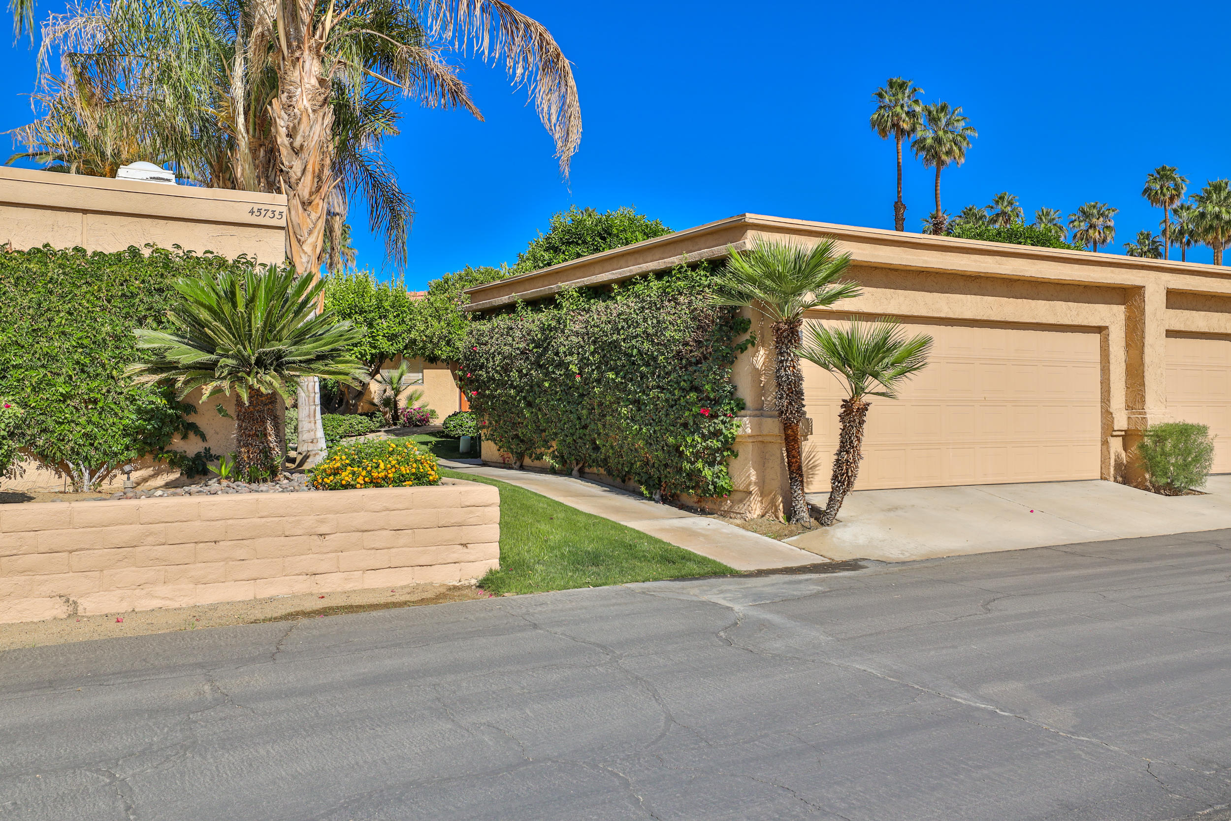 Much sought after Sandpiper Condo behind the gates of the Indian Wells Country Club with magnificent Southwest Mountain views!  Savor your views of mountains, manicured gardens and inviting pool from the living room, dining room, updated open kitchen with granite counter bar.  The 2 spacious bedrooms are en-suite with granite counters, large showers, walk-in closets and both with access to the private enclosed patio.  Separate Laundry room accommodates full size washer/dryer with ample storage.  Two car detached garage is only steps from your unit. Property Owners of Indian Wells can receive discounted rates at IW Golf Resort and other IW restaurants.