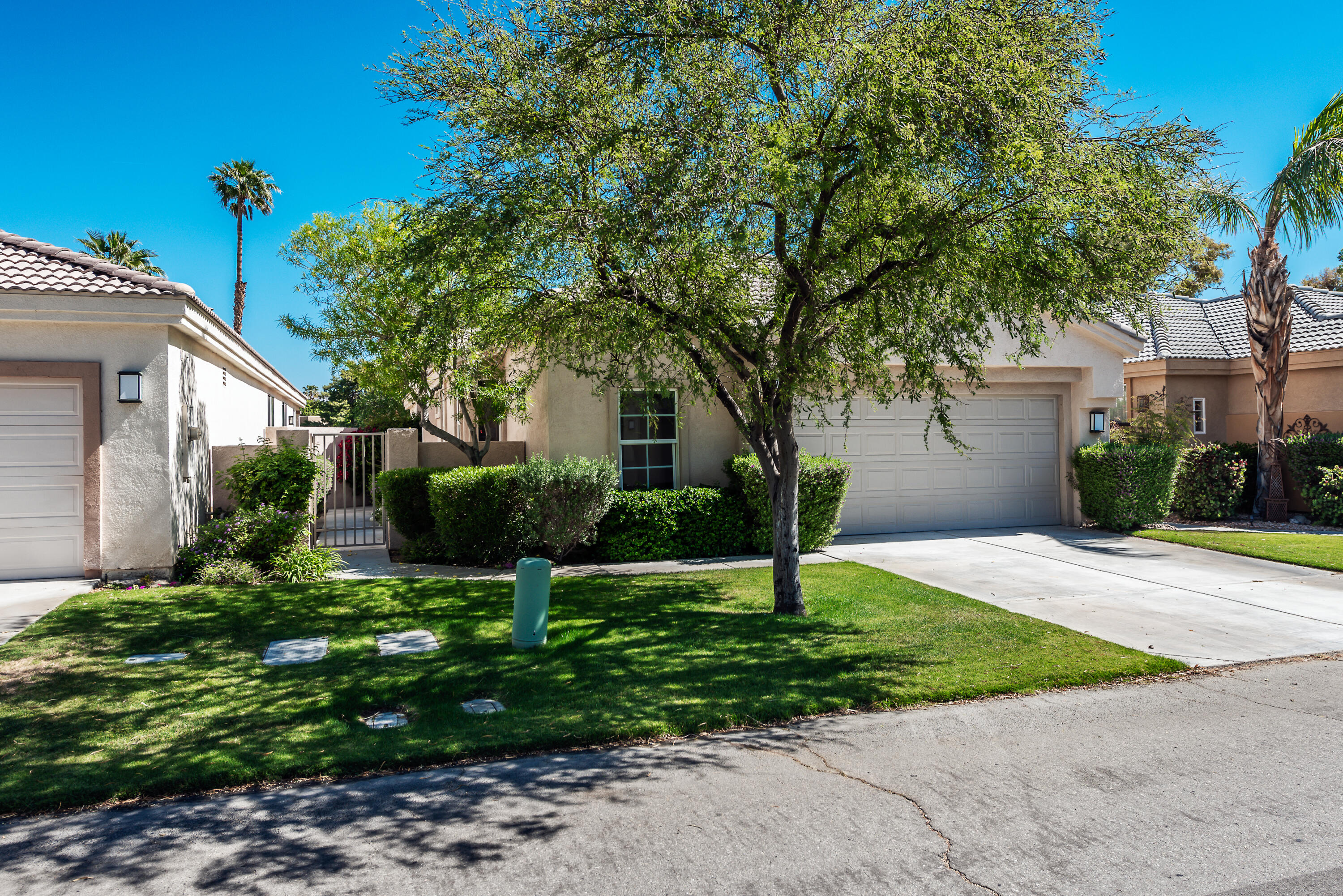 This lovely 2 bedroom 2 1/2 bath home offers very light and comfortable golf course living on a quiet, interior street in Desert Princess Palm Springs. The Living Room features Gas Fireplace and large, bright windows! The Kitchen boasts Granite Counters, a Breakfast Bar & a nice sized Walk-In Pantry!  This home also features two master suites with Private Baths & Closets with One of the master suites offering a large bonus room perfect for a workspace or additional space for guests or storage Separate Laundry. The Large Two Car attached Garage offers plenty of room and some additional storage. The Covered Back Patio provides beautiful views of the luxurious Desert Princess golf course! The home has been well maintained and many upgrades have been completed since the current owners moved in.  Desert Princess offers a 27 hole golf course, clubhouse and pro shop, 35 pools & spas, tennis, pickleball, bocce ball, full exercise facility, racquetball, relaxing spa and miles of roads to walk all in a private, gated community.  Minutes to Palm Springs & all the valley has to offer. Many more details are available upon request.