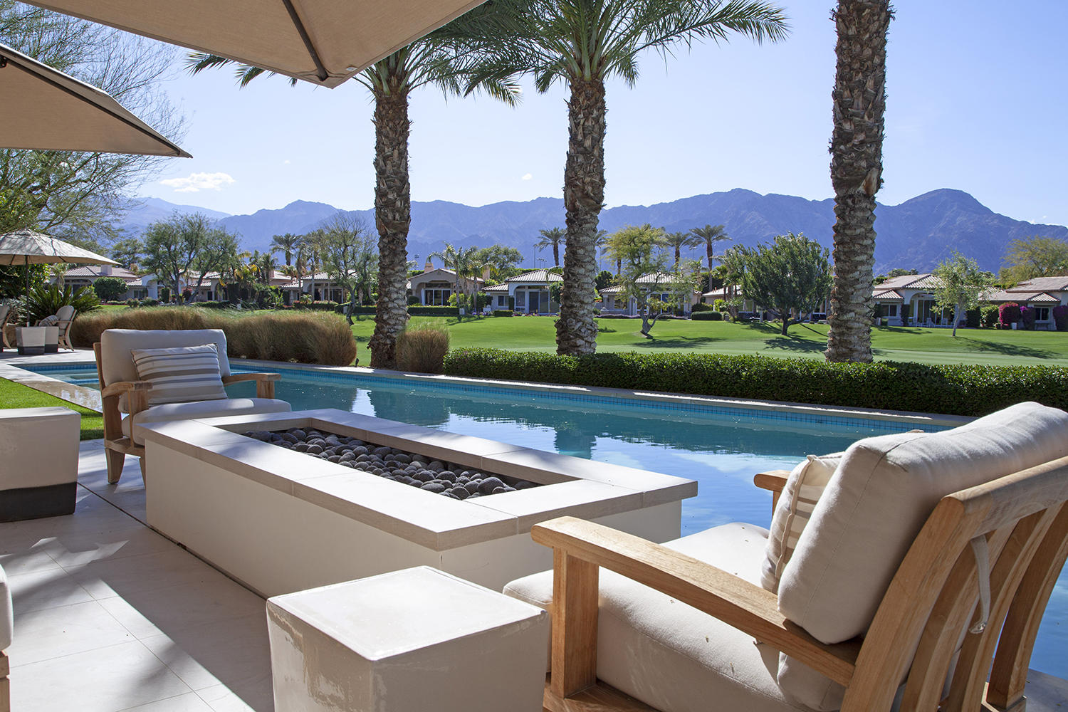 An extraordinary contemporary desert home uniquely positioned for maximum view. Dramatic views of the majestic Santa Rosa Mountain and rugged foothills. Highly elevated above water and the 14th fairway of the Robert Trent Jones Jr. Championship Golf Course. Placed at the apex of an intimate cul-de-sac. Sensational linear pool is perfect for entertaining your crowd or doing your laps. A chic Turkish limestone walkway welcomes all at the entrance. This limestone is also the perfect fit for pool side and patio. Elongated fire pit accommodates family and friends. The secondary patio is a wonderful relaxation zone. Large BBQ island with a wolf grill and seats all who like to hang with the chef. Enter the luxury attached guest casita via the homes private courtyard. Large side yard welcomes all four legged friends! This is an extraordinary and transformational remodel. Enter through translucent glass and wood entry doors. Polished travertine flooring. Impressive audio / video wall with high end electronics. Multi-panel sliding door collapses to a single pane for an immersive indoor / outdoor experience. Kitchen has been completely reimagined with features that include rift cut white oak, Sub Zero fridge, Wolf range, wine fridge, secondary fridge. Master bedroom retreat has a French door to the spa and barn door to the fabulous bath with its own outdoor garden shower. Furnished per Inventory List. 3-car garage.