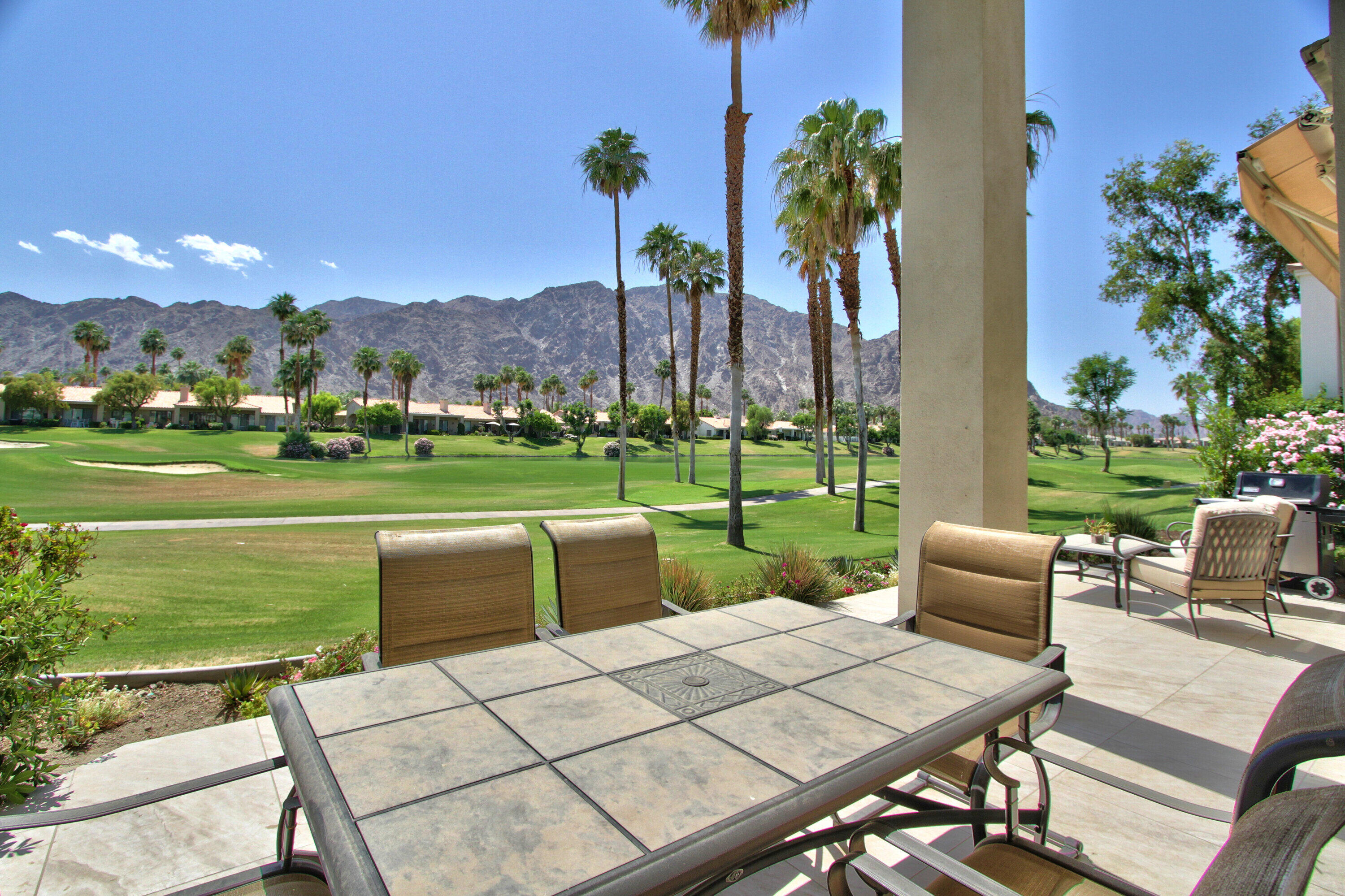 Priced to sell! Mountains mountains and more outstanding large Mountain views! This home is located on the 7th hole of the Arnold Palmer private golf course at beautiful PGA West. At night the mountains are lit up and the sunsets here are absolutely spectacular. The back patio has been extended for additional outdoor enjoyment. The home has been remodeled extensively and no expense spared to include new bathrooms, new ceiling fans, new LED lighting, fresh paint throughout entire interior, new cabinets, new flooring, new televisions and new furniture.Furnished per inventory list. This is a must see home. Community pools and spas within walking distance. Call now for a private showing.