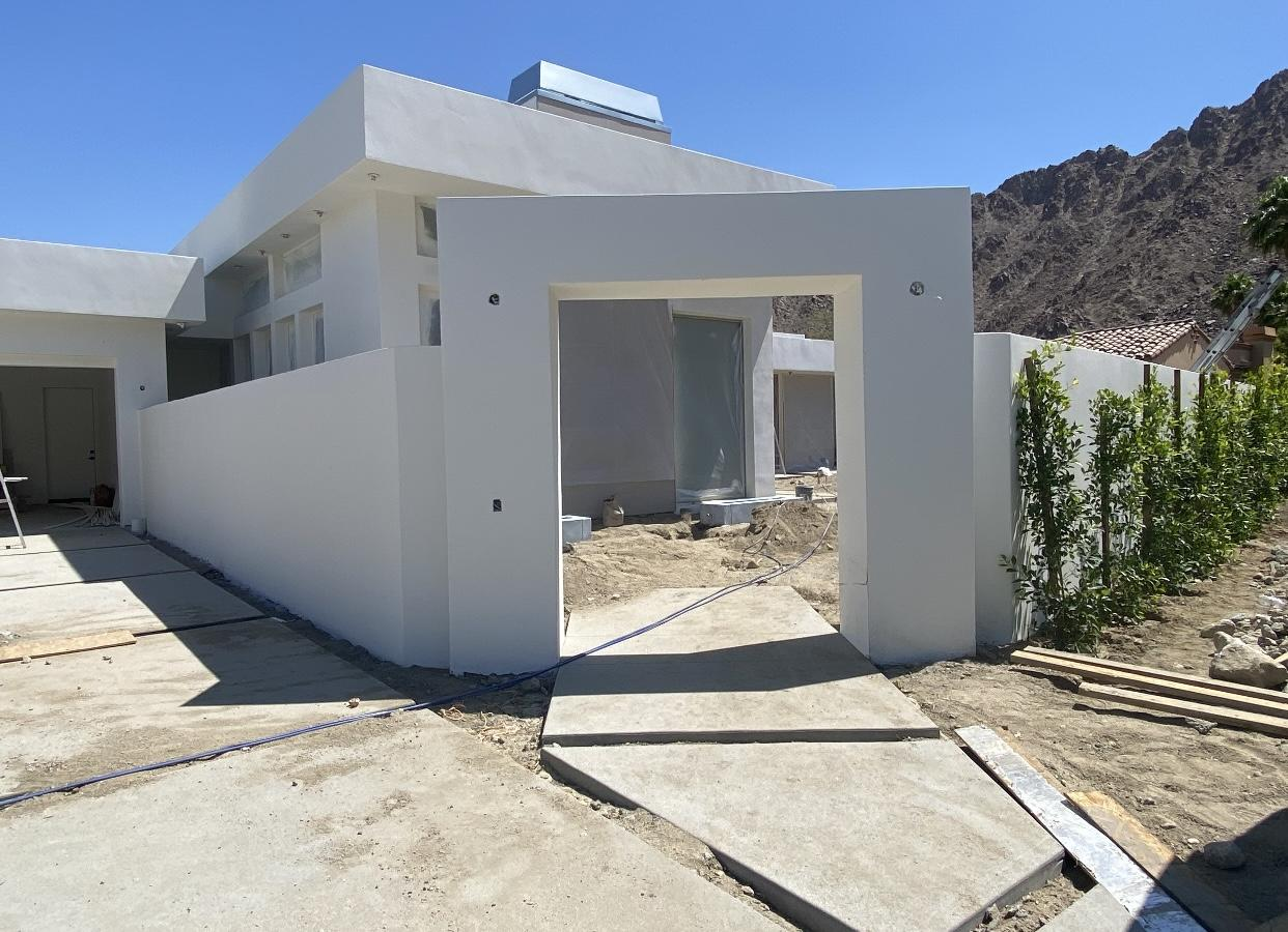 This modern brand new construction is DROP DEAD GORGEOUS! Nestled in the private enclave of Flores Montanas are only a handful of custom built, large estates which sit literally right up against the mountains & this one has views you have to see to believe. This newly built stunner commands the entire street with its strong presence and sexy lines! Upon entering this completely walled in and private courtyard, you will be greeted by 2 in-ground custom fire troughs, thoughtfully placed artificial turf, custom landscape, an oversized zero-edge pool with gorgeous custom tile work, and extra-large baja step to take in the most amazing mountain views. The builder didn't want to stop there so he also built 2 custom BBQ counters and a firepit right outside of the master for ambiance. This glass house is just that, built with numerous La Cantina pocket doors that all open up for indoor/outdoor feel and windows everywhere. As you enter inside by a custom all glass front door operated by a keypad, you will step into a grand open floorplan with 14 ft. ceilings and take note of the huge plank tile floors, custom cambria counters throughout, gold hardware & fixtures, as well as custom lights.  Featuring 4 bedrooms, each with their own en-suite bathroom, a homework/media station in the hall, & even a stunning mini butlers pantry/laundry area with barn door, floating shelves & coffee bar. The master suite features dressing area & decadent soaking tub. This is unlike anything on the market!