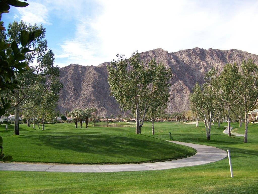 Location! Location! This condo is arguably one of the best west locations in the popular world famous Palmer Private Course at PGA West. Enjoy the incredible sunsets & rugged west Santa Rosa mountain, lake & sweeping golf course views of the 5th fairway from your own back patio! The mountains are lit up at night & owners often get a glimpse of the Big Horn Sheep roaming the area. This sought out Champion floor plan is perfect for a weekend retreat, investment property or a full time residence. It features the popular open floor plan concept & consists of approx. 1,330 SF, 2 BDRMS., 2 BA.  Enter the charming courtyard & walk into the foyer & you will be immediately impressed. One will enjoy the living room with its high ceilings, fireplace & wet bar offering spectacular views of the Santa Rosas. A formal dining area is near-by & is perfect for intimate gatherings. The chef kitchen with a dining area offers granite slab surfaces & stainless steel appliances including an updated dishwasher & new refrigerator. The slider door off kitchen accesses the courtyard patio & is perfect for barbecuing. The master bedroom suite overlooks the golf course & is well separated from the guest bedroom suite which overlooks the courtyard. 2 car garage. Other improvements are new travertine floors in master bath, newer water heater, updated HVAC∾ new exterior paint & in the Master Suite and Guest Bedroom Suite.  The community pool & spa are just steps away. Offered furnished per inventory.