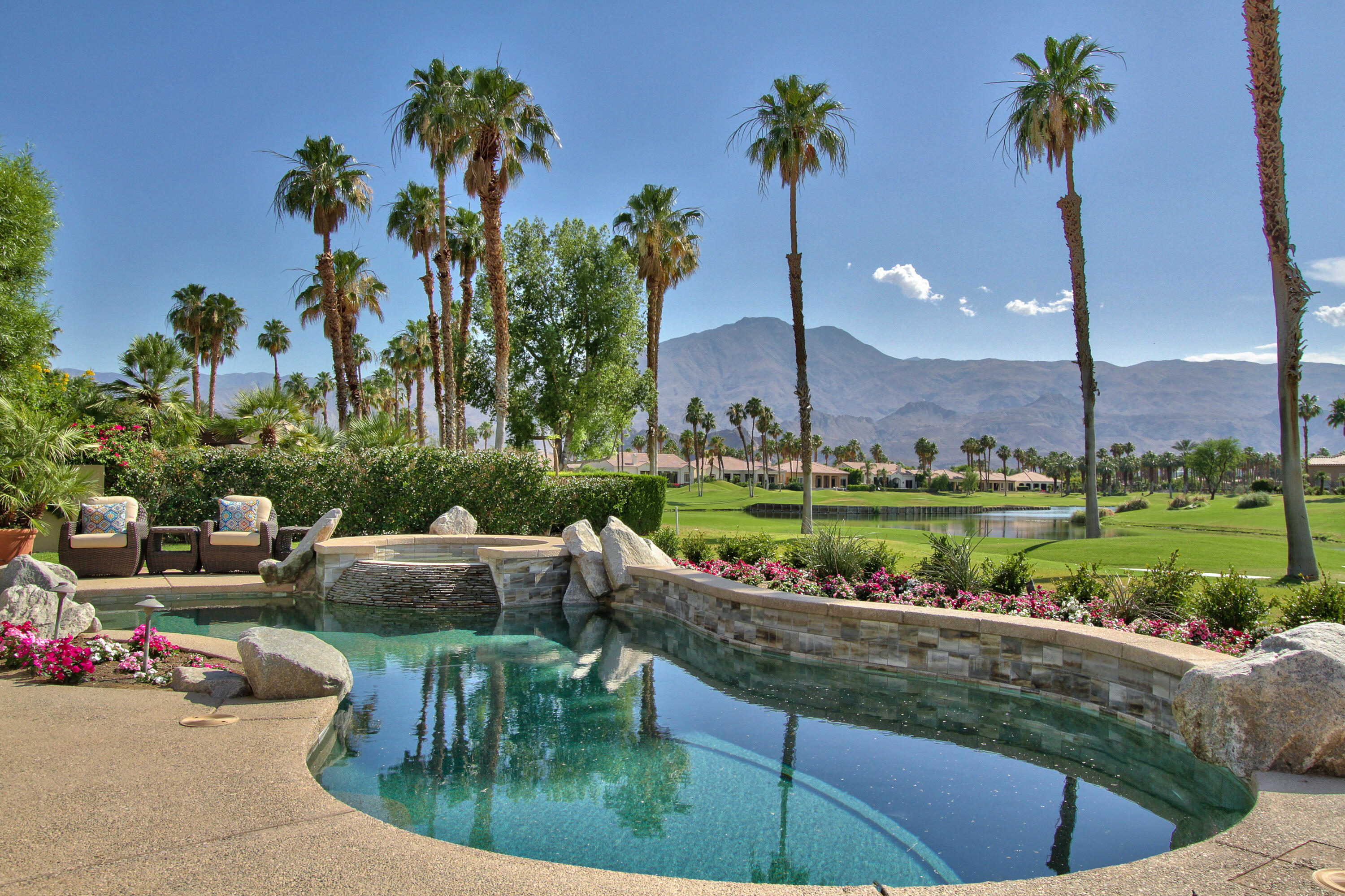 Mountains, mountains, and more mountain views! Panoramic  mountain, fairway, lake and island green views abound on this gem located within the Legends gate at beautiful PGA West. The home is situated on the semi-private world famous Jack Nicklaus golf course, away from incoming balls, and has four 4 bedrooms plus bonus room for family enjoyment. Newly remodeled, this home boasts fresh paint interior and exterior, has new TVs, new LED lights, new furniture and bedding, and new ceiling fans. House has two master suites in addition to a two-room detached Casita. Enjoy oversized backyard with large covered patio, overlooking lagoon pool and spa. Also retreat to the covered patio and listen to the beautiful waterfall feature. The sunsets here are absolutely spectacular! Low HOA's. This home is furnished per inventory.  Call now for a private showing!