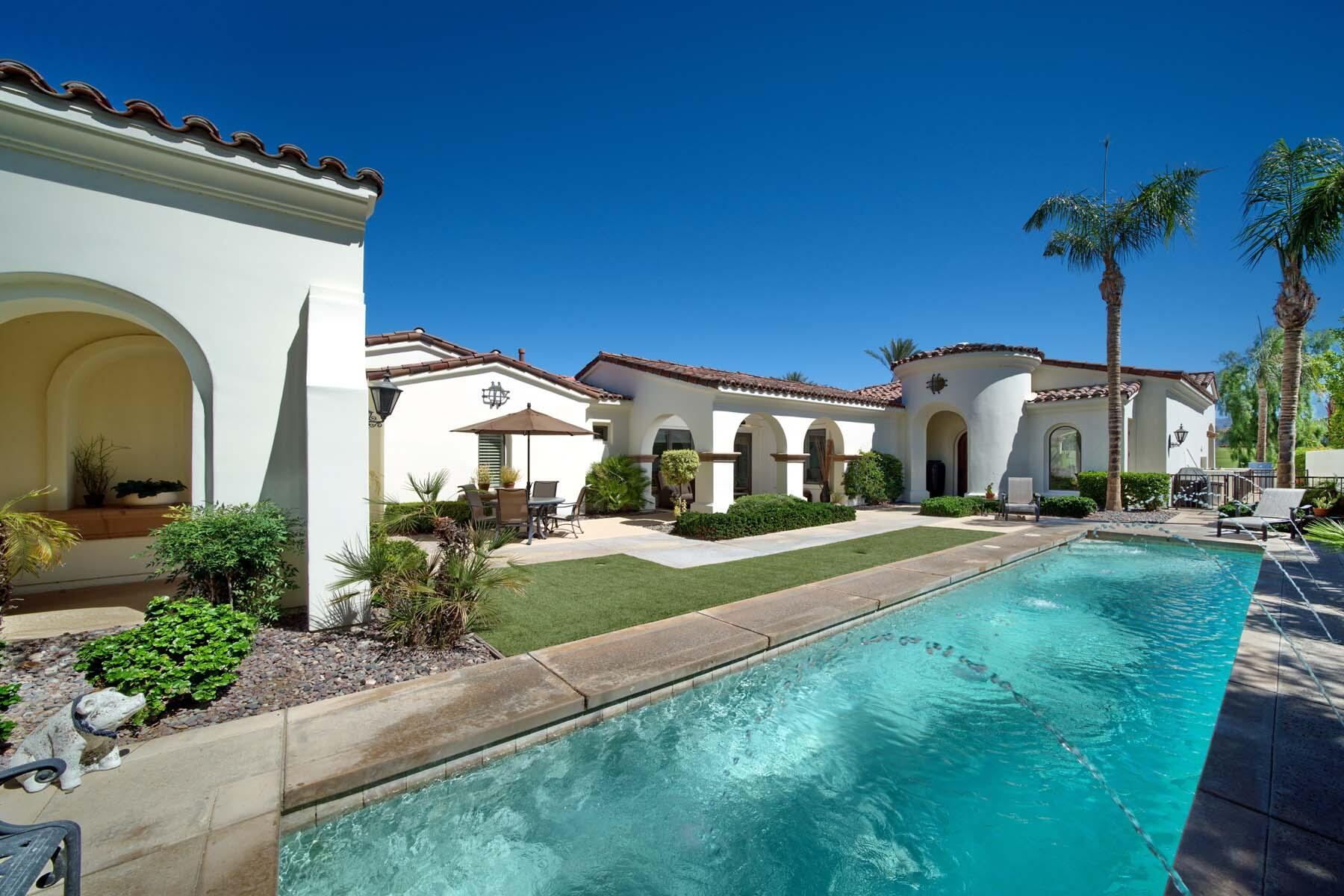 This double-pool desert retreat awaits behind the gates of Toscana Country Club. The sizable lap pool with water features in the courtyard offers a sunny sanctuary for leisure or a brisk workout from the comfort of your home. With stunning views of the Jack Nicklaus Signature Golf Course, the pool-sized spa in the backyard with waterfall grants relaxing room for entertaining guests.  Inside, custom built-ins with recessed LED lighting - both in the great room and master bedroom, two sets of floor-to-ceiling sliding glass doors, and the light and bright colors are just a handful of finishes that make this Early California home stylishly contemporary. The gourmet kitchen features expansive granite countertop space with breakfast bar and separate island, as well as cabinet panel-matched refrigerator and top-of-the-line stainless steel appliances.  Escape to the master bedroom with luxurious en-suite bath showcasing a large soaking tub, while guests can retire to either of the guest rooms, each with their own en-suite.