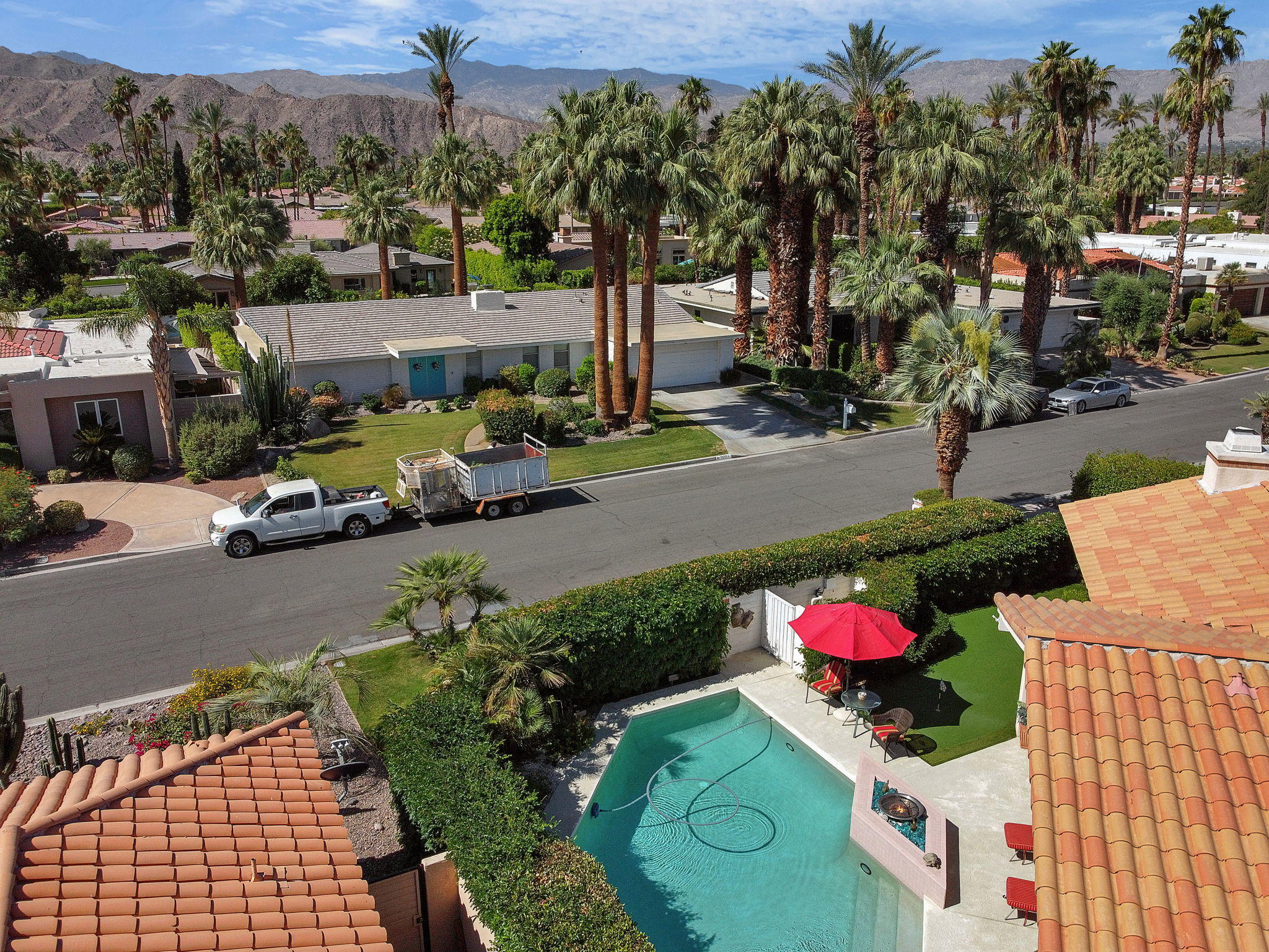 This beautiful custom built home has everything you can want in Indian Wells including a southern mountain view. This 3 bedroom and 3 bath home also includes a bonus room attached to the master.  The open floor plan flows from the great room to the kitchen to the beautiful patio and includes large windows providing the views of palm trees and mountains.  Once on the patio, enjoy the pool and spa, or the outdoor dining room with TV, or play a few holes on the putting green.  The home has been built on the lot specifically to take full advantage of the beautiful southern views.  There is a 3 car garage, one with an oversized garage door to allow for a larger car or over sized toys.  The master suite has 3 closets that are custom built, a marble fireplace, and you will wake up to scenic views every day. As an IW resident, you have privileges at the famous Indian Wells Tennis Garden and enjoy 20% off on all Indian Wells 5-star resorts, dining, and golf with your Indian Wells residence card.