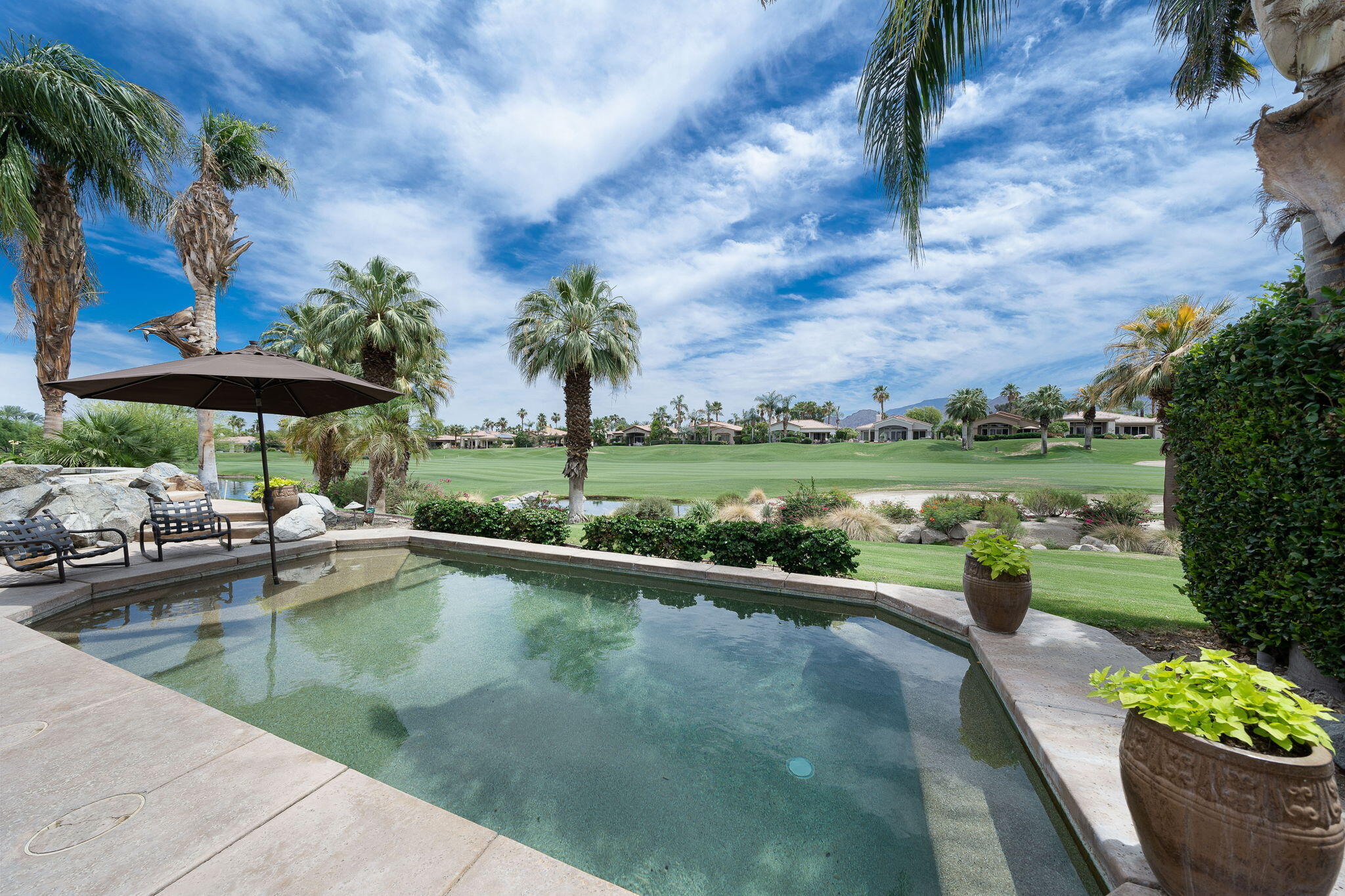 South-Facing Updated Pool Home! Stunning & expansive south views of mountains, lake & course Arroyo #9. This Ocotillo 2G is updated throughout w/beautiful finishes & details. Patio pool area is perfect outdoor space for dining, lounging & entertaining! Sweeping south views of lake, mountains & fairway. Fabulous back patio feels like your own private resort! Patio w/pool, spa + waterfall & builtin BBQ. Open floor plan – living room, dining room, wet bar, family room...this Great Room is one big entertaining space! All indoor living & dining areas open out to the patio & have great views. Wood-look ceramic tile flooring throughout + high-end carpeting in bedrooms & living room. Electric solar shades & grasscloth wall covering in Great Room. Living Room highlight is fireplace w/beautiful opalescent inset tile surround. Family room is great for movie nights w/wall speakers & custom built-in for flatscreen TV/electronics.  Kitchen has granite counters, wine refrigerator, walk in pantry + movable island. Wine refrigerator in wet bar. Master bedroom features gorgeous contemporary builtin cabinets + 2 closets (1 walk-in). Master ensuite bathroom offers dual vanities, spa tub + separate shower. The 2 guest rooms feel like a luxury hotel – both are en suite, appointed beautifully & provide great privacy for your guests. Attached Casita is just off the courtyard – 1 bedroom + ensuite bathroom.  Attached 2 car + golf cart garage. Golf or Club membership available. Furnishings available.