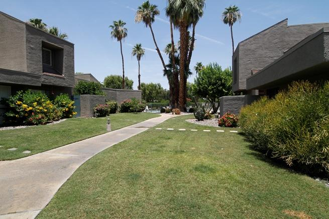 This is Totally Redone with a tasteful Spanish theme. Modern smooth pavers on the whole first floor and carpet in second floor bedrooms. Nice patio right off the living room with door to common lawn area and pool. AC is approx 5 years old and water heater 1 year. Grab your toothbrush and move  in ( seller will provide detailed  picture inventory) Community pool and spa is just around the corner.. This location can't be beat with the Omni and River literally across the street. Desert Village is a friendly 86 unit dev with a combination of full and part time owners. Carport #39 is 3rd or 4th space from the end.  The Mailbox is on wall opposite our back patio.  There are 3 pools, 2 hot tubs and a tennis/pickle ball court.