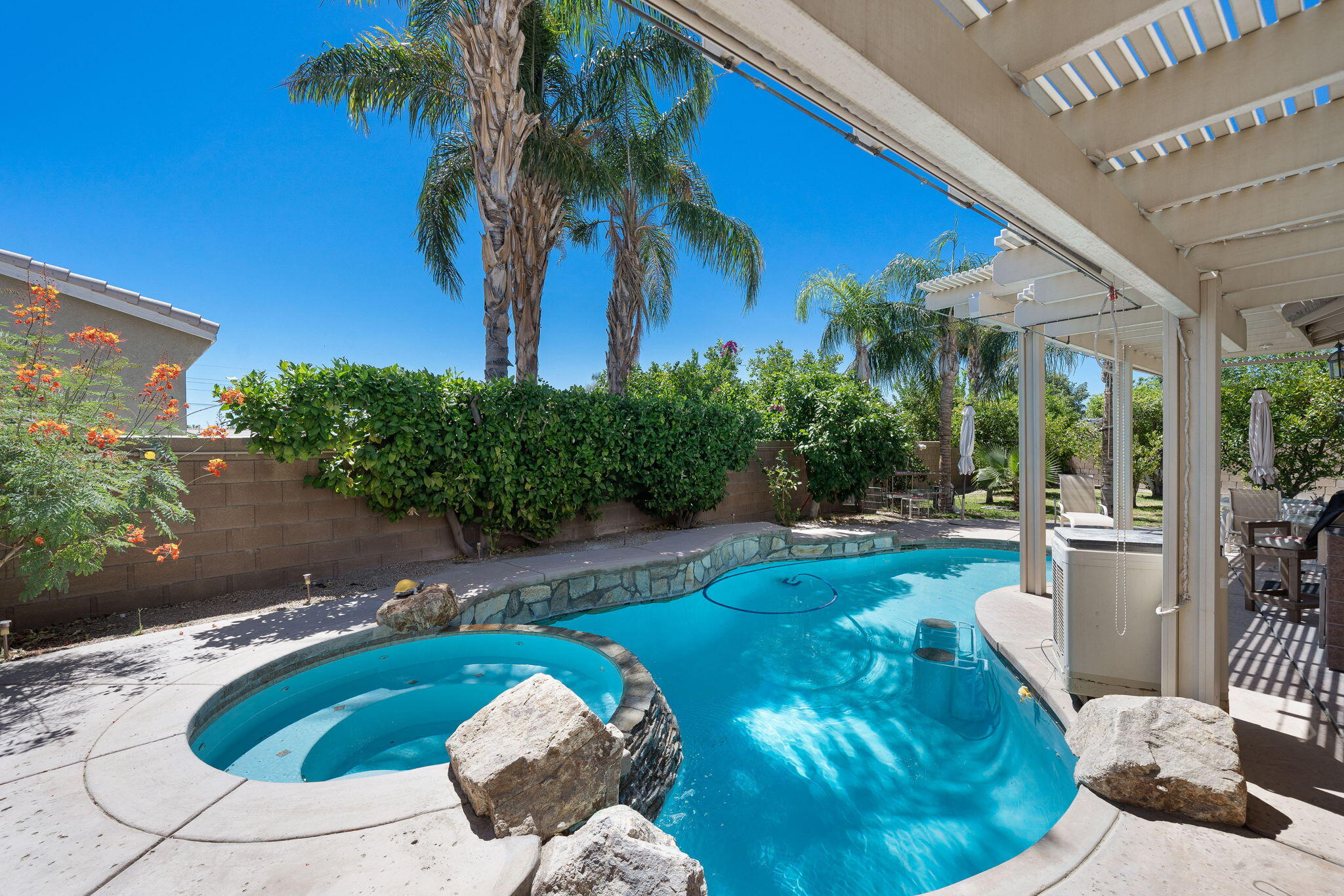 Meticulously maintained Las Brisas II home with inviting pool and spa, RV parking, and a 9,148sqft. lot on a private cul-de-sac location. Residing in a 55 plus community, this single family residence has 1691sqft. of interior living space, including 3 BD/2 BA, den/office, & separate dining area. The great room has a dual-sided fireplace, vaulted ceilings, nice architectural detail and open feel. The adjacent and functional kitchen has a large breakfast bar, tiled countertops/backsplash, with accent tile and bullnose edging. Also features pendant lighting, glass door walk-in pantry, built-in microwave and great pool views. Upgrades are abundant throughout this home, and include a Boss whole-house Water Softener with purification system, Hunter Efficient Water Landscaping Sprinkler System AND a Zoned High Efficiency Cooling and Heating System, w/Electronic Air Cleaner and UV Light Air Purifier. The front yard has desert landscaping while the back features a salt water pool & spa, w/stacked stone spillover, multiple pergolas, extensive Zoned Mister System, fruit trees, & a built-in Lynx BBQ grill with swamp cooler. The double garage has cooling & heating with Electronic Air Cleaner (w/UV purifier) and separate swamp cooler. The garage is also completely finished & insulated, w/epoxy flooring; the attic is insulted too w/storage above garage. A hard-to-find RV parking enclosure (overall 20x60 feet) with alumawood cover, electric, sewer & water hook ups. Make an appointment today.