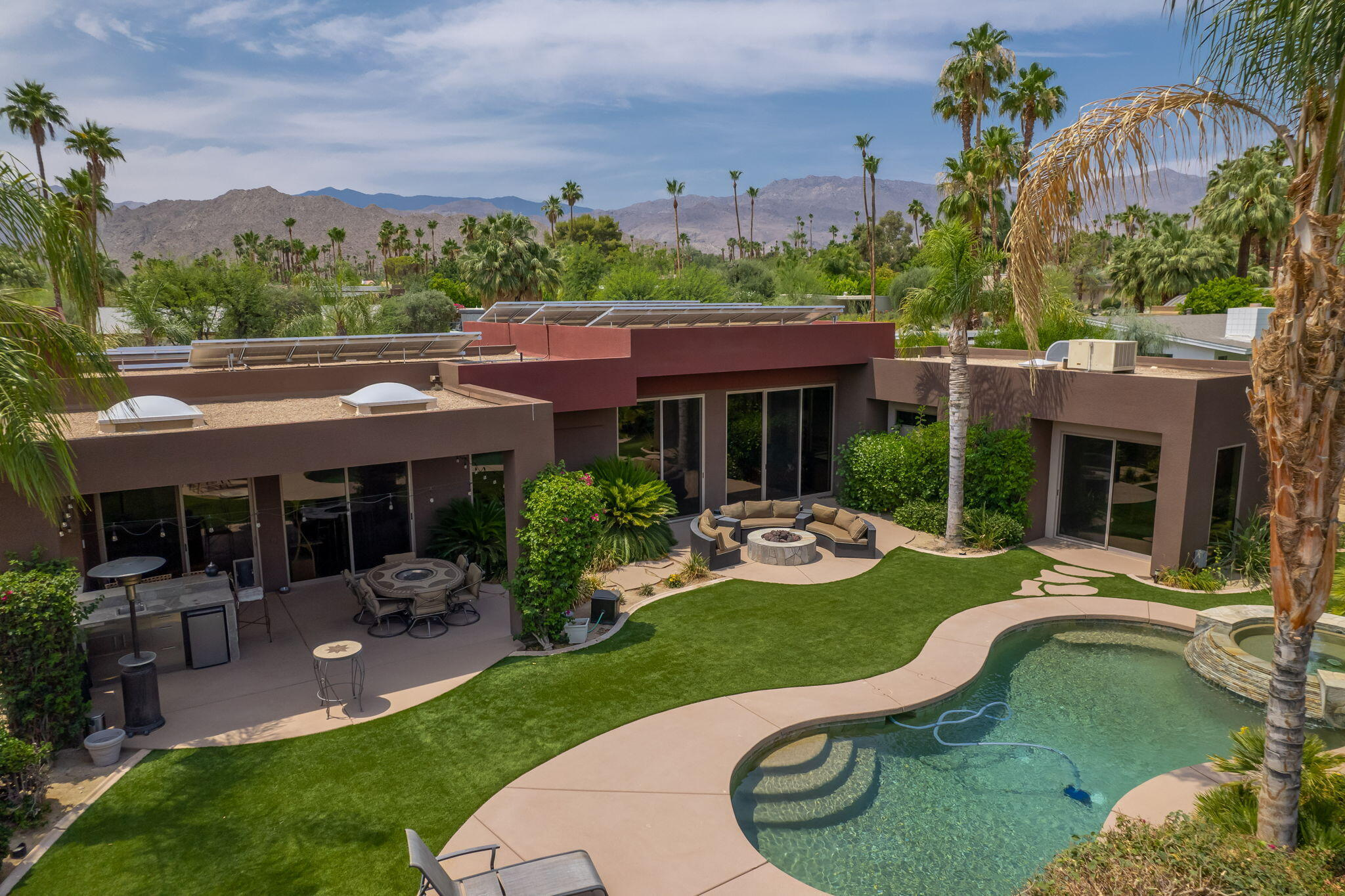 Never before on market, is this gorgeous Rare Find, sitting in the hills of South Palm Desert.  Custom built by the original/current owners, this home exudes pride of ownership!  From the full paver drive and walkway, enter through massive stainless double doors, where you are welcomed by soaring 12' ceilings, and an open floor plan giving you the sense of spaciousness.  Each of the 3 guest suites have their own bathrooms and patios, giving them their well deserved privacy.  Lending to this home's efficiency are bronze tinted, dual-pane windows with high performance low-e coating, and a 52 panel, fully owned solar system.  Other amenities to this gorgeous build include 4-zone air conditioning, one zone alone being for the 3-car garage, two high end evaporative coolers, 4-zone speaker system, and electronic power sun shades covering the windows.  When you are ready to relax, exit out back to your private backyard oasis, where you will find a covered patio with a custom built bar, room for plenty of seating, gas fire pit, and to top it off, a glistening salt water pool and spa.  This is desert living at its finest!