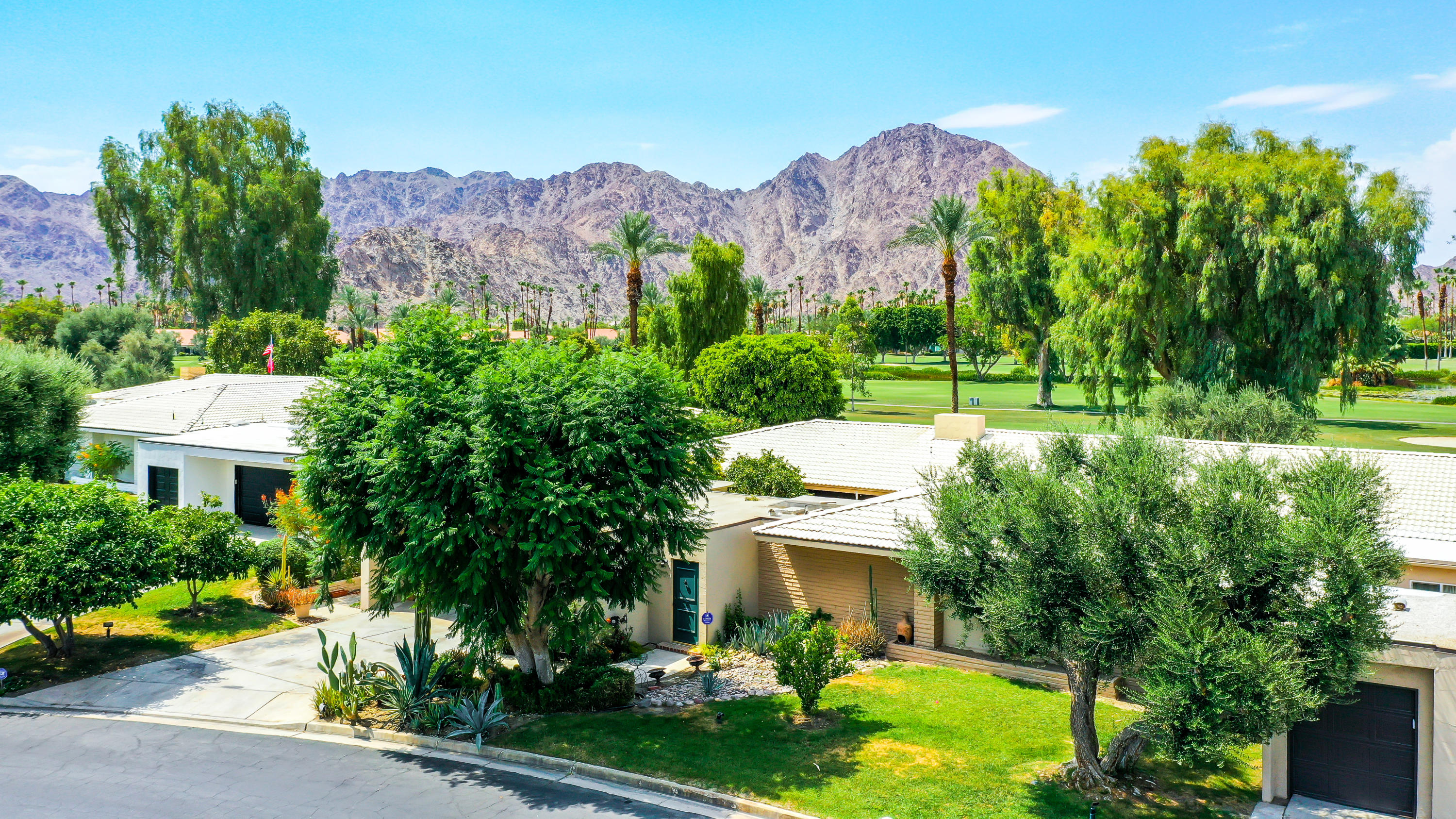 (*Coming Soon*) Million dollar location in a fabulous hidden enclave in South La Quinta. This spacious 2300sf  floor plan is located on an elevated lot overlooking the 1st Fairway - within walking distance to the famous La Quinta Country Club clubhouse. Breath taking mountain views across 4 fairways from interior living spaces and back patio. This is a clean palate waiting for your personal lifestyle changes to the interior.  This floor plan offers an interior courtyard which you can convert to living space or maintain for organic atrium enjoyment.  There is Catch & Release fishing plus battery operated boats allowed on lake. The 3rd car bay in the 504sf garage has been converted to den. Low cost IID utility district. No mandatory membership.  You own the land. The low $600-mo HOA fees include exterior building maintenance and exterior landscape maintenance - see attachments. More photos coming