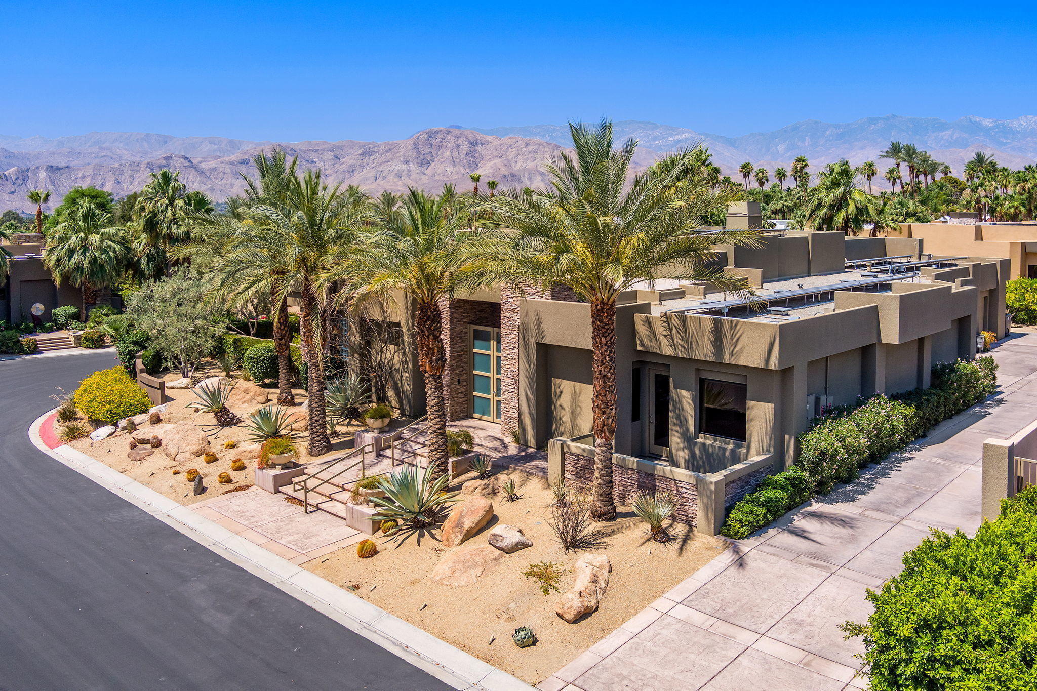 Stunning,180 degree mountain views, handsome, contemporary home has floor to ceiling Fleetwood doors and windows, spanning across entire length of house filling  rooms with an abundance of natural light and dramatic mountain view backdrop.  Enjoy convenience of Motorized shades w/several black out shades as well. Large home, just shy of 5,000 sq.ft. with 4 bedrooms includes the Casita.  Separate entry from interior courtyard to casita w/builtins, bathroom, closet and kitchenette w/sub zero refrigerator w/ice maker & microwave.  Tall, Glass double door, electric entry to Elegant living room with travertine flooring, coffered ceilings, marble fireplace,& builtins looking at 49 ft. lap pool. Pristine and practical, this home runs on solar energy & panels that are owned. Dining room with built in cabinets and great room with open kitchen. Stainless steel Wolf range, Meile dishwasher, Sub Zero Refrigerator, granite counters and tons of cabinets, storage &  w/ walk in pantry. Master retreat w/fireplace & builtins, dual organized closets & baths. Wake up to sparkling pool, brilliant blue skies, and views of  magnificent mountains from your bedside. Three car garage w/ electricity for Tesla or any other electric car, buyer to verify.  Additional vacant parcel adjacent to home is for sale too. Ask Agent for details.