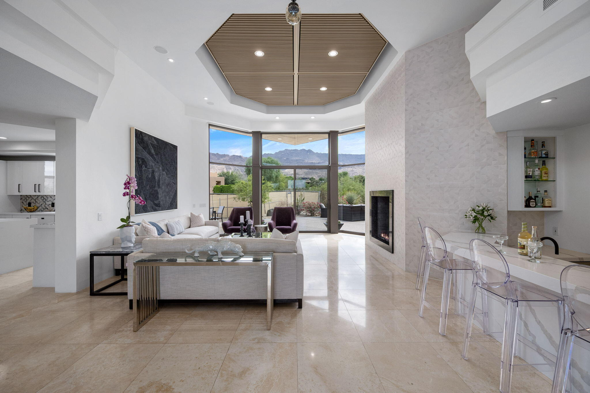 Located within the exclusive Bighorn Golf Club community, this newly remodeled home offers exquisite design, an open floor plan, and spectacular golf course and mountain views. Inside, enjoy a family room, dining room, living room with a sunken bar, a glass-enclosed wine wall, and a kitchen with crisp white nano glass countertops and modern appliances. The luxurious primary suite features a fireplace, sitting area, an elegant bathroom with a freestanding tub, and a walk-in closet. The additional two other bedroom suites offer their own design details and comforts. An attached casita includes a separate entrance and the backyard boasts a newly renovated pool, spa, an outdoor barbecue, and ample entertaining space that looks towards the 18th hole in Bighorn's Mountain Course.